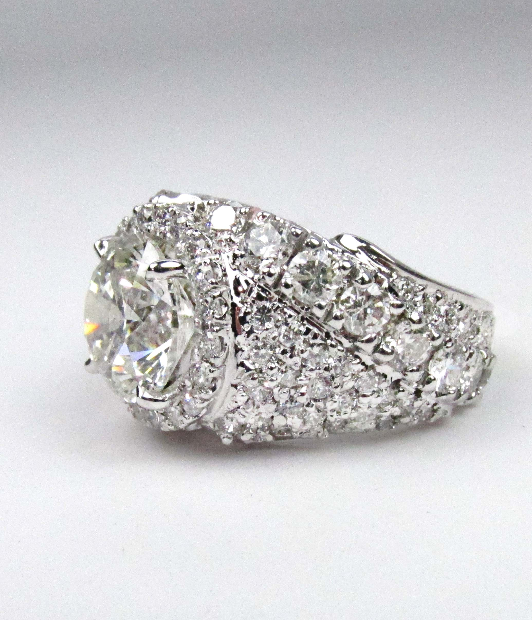 pave_engagement_ring_with_halo_redford_jewelers.jpg