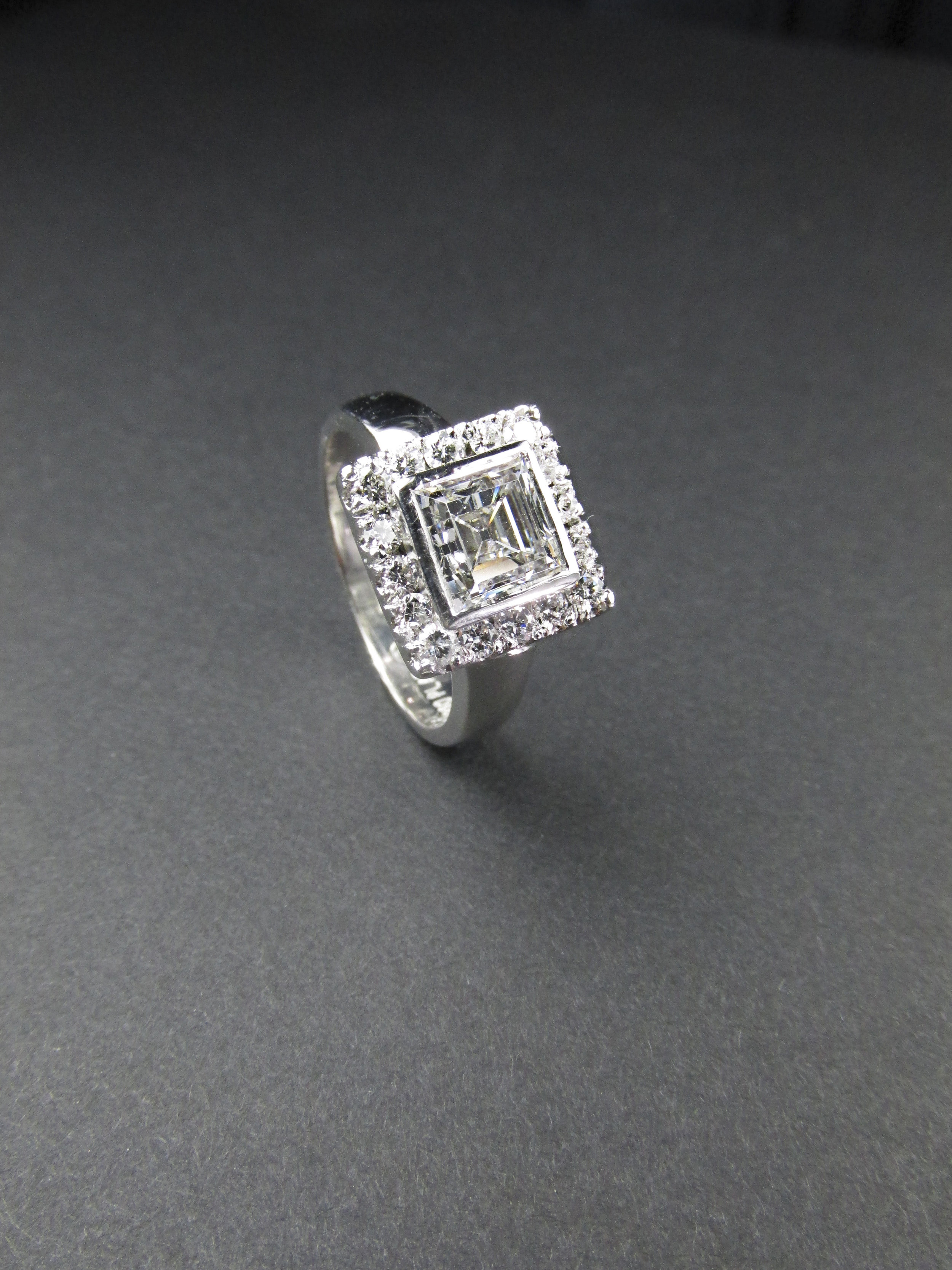step_cut_square_diamond_ring_halo_platinum_redford_jewelers.jpg