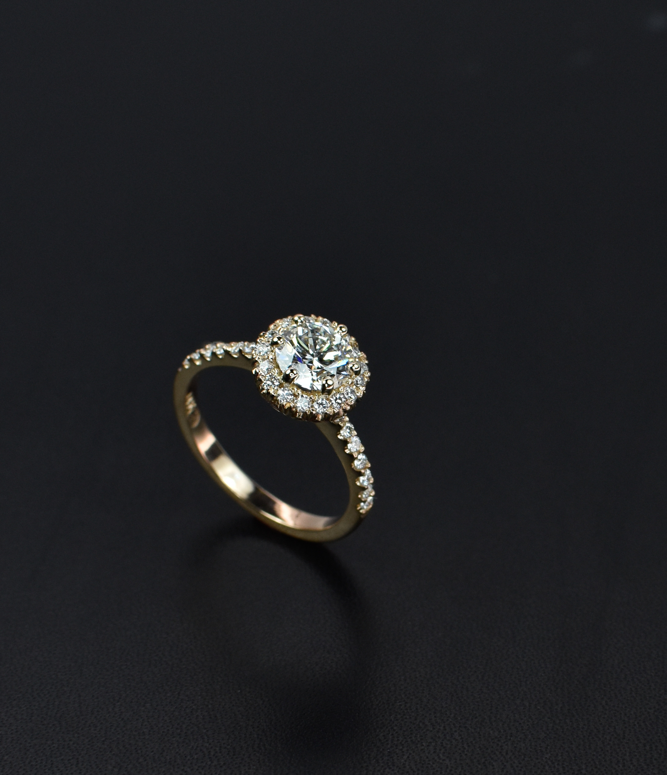 rose_gold_halo_engagement_ring_2.jpg