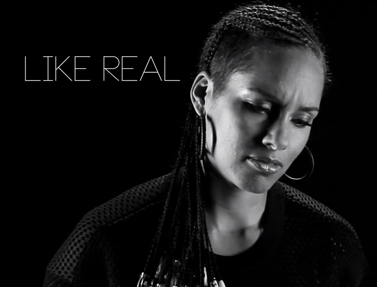 Alicia Keys in the small leather woven earrings.