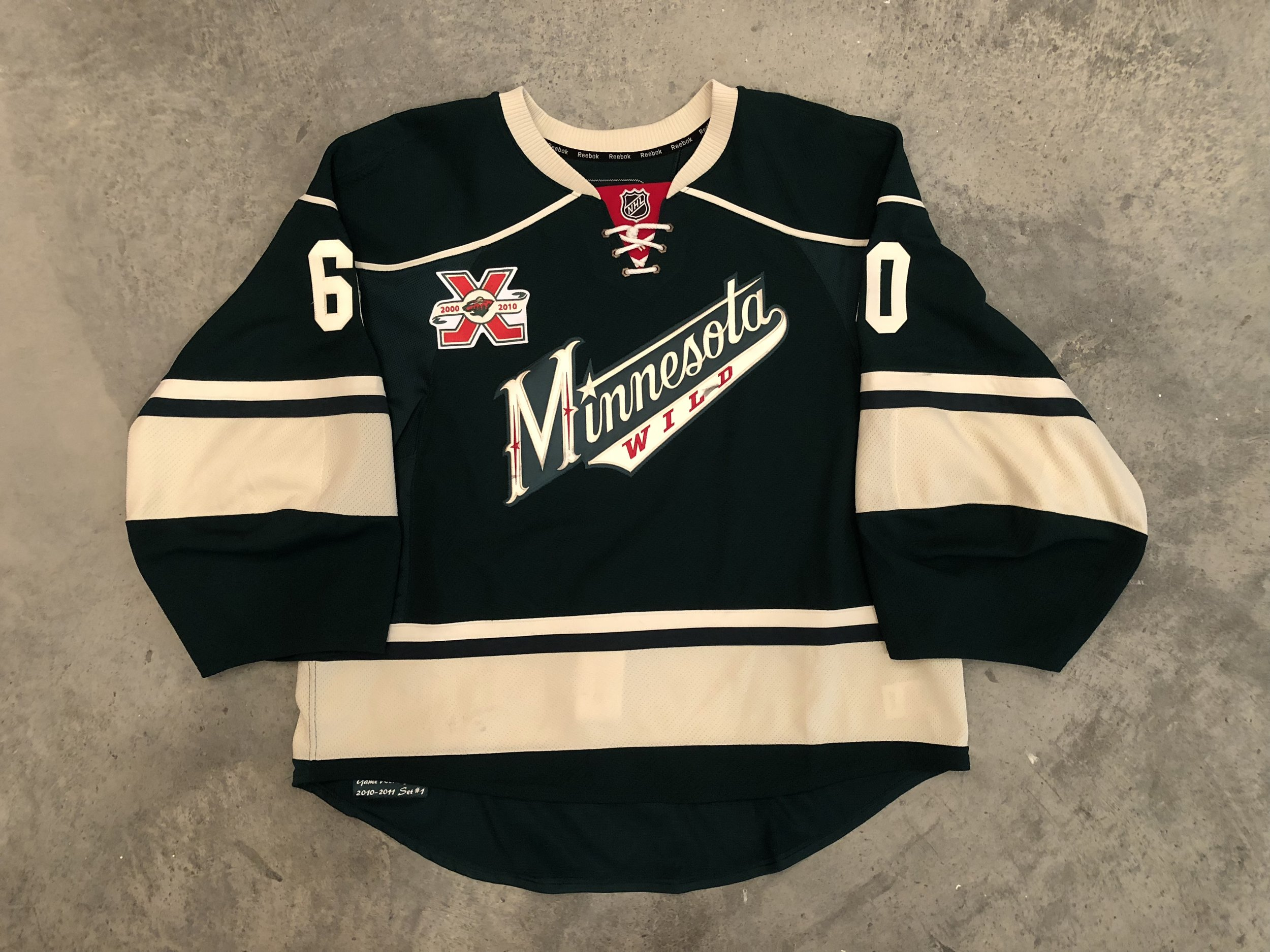 2010-11 Jose Theodore game worn home jersey with Wild 10th anniversary patch