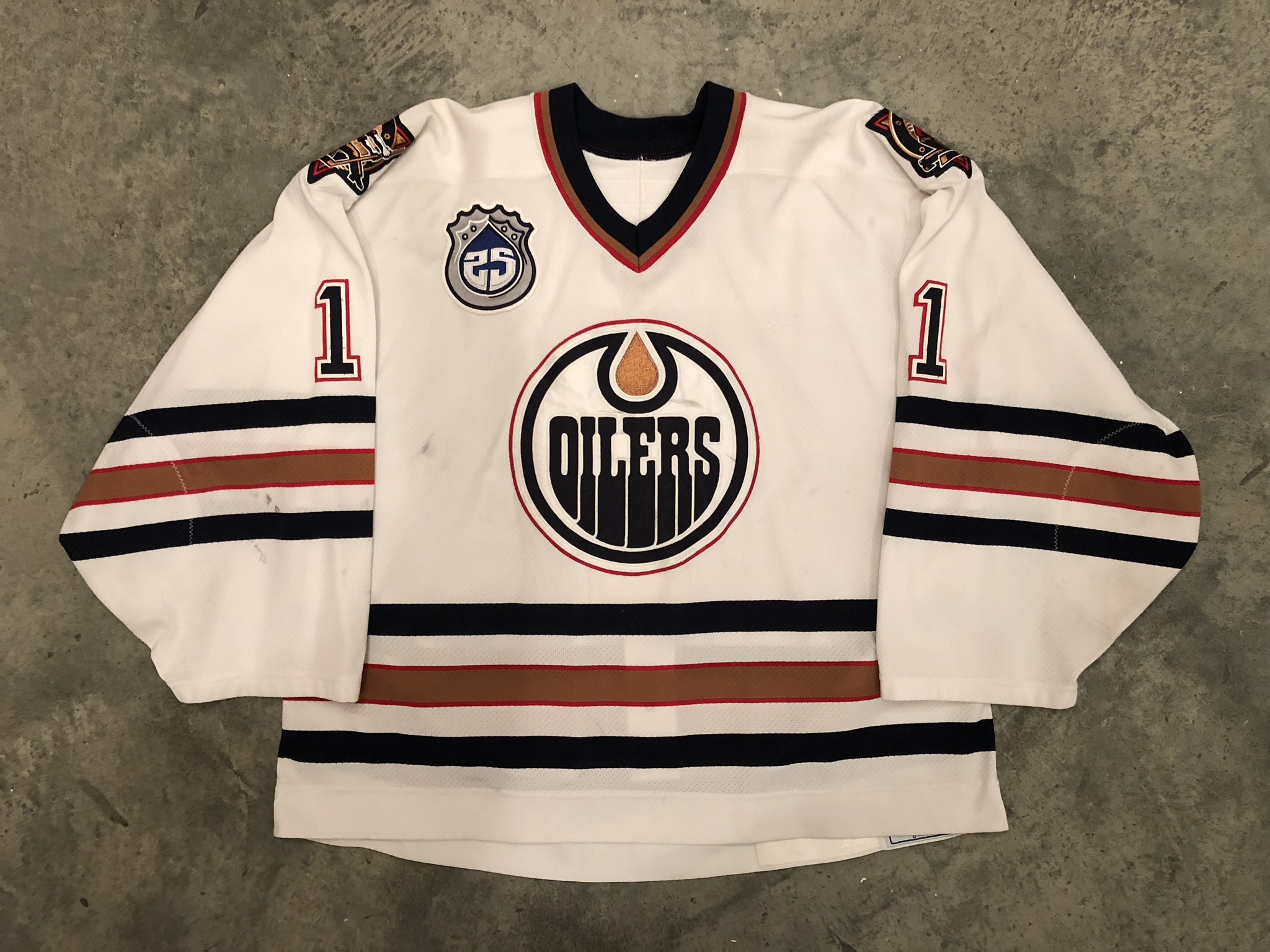 2003-04 Ty Conklin game worn home jersey with the Oilers 25th anniversary patch
