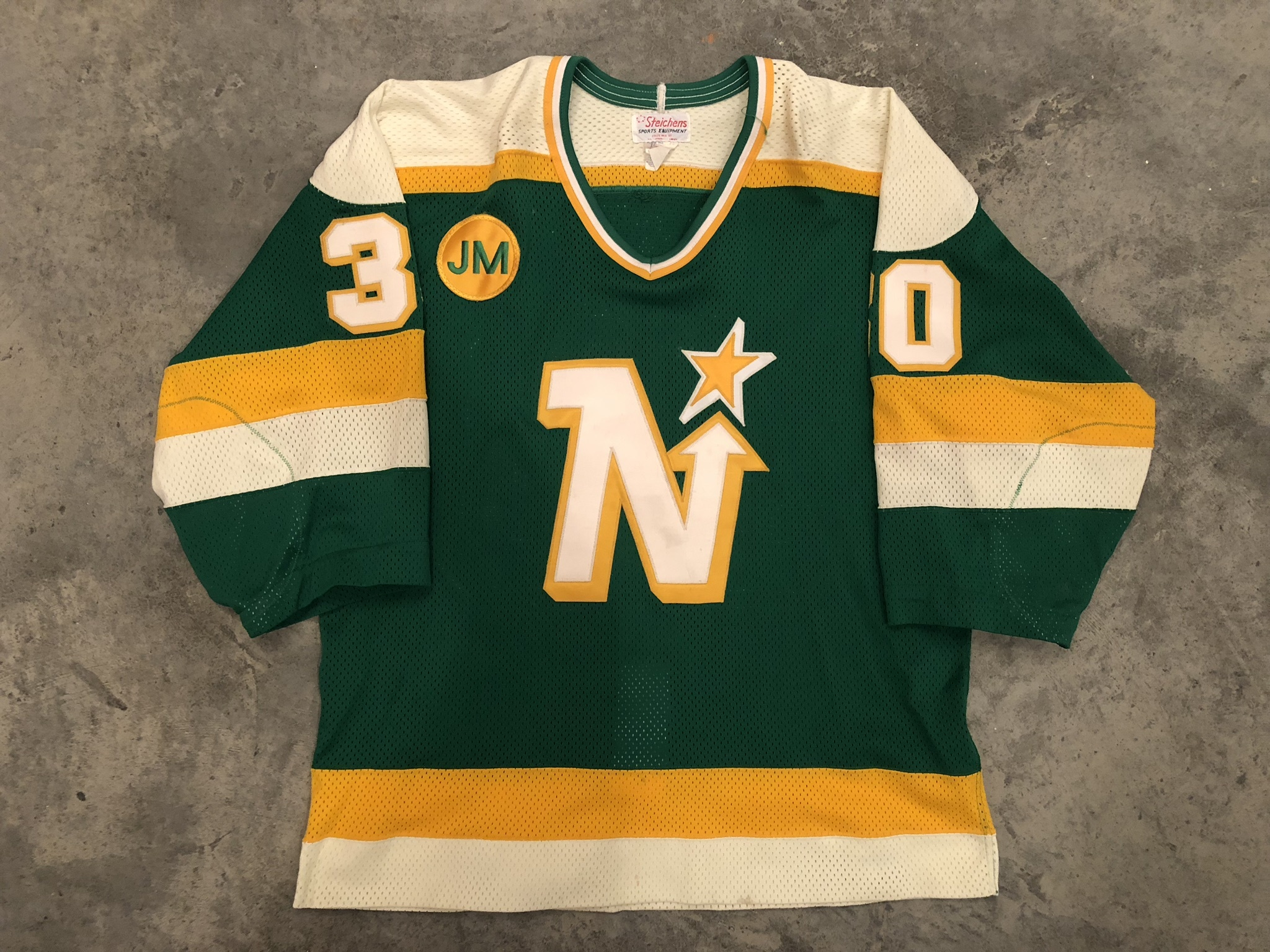 1987-88 Jon Casey game worn road jersey with JM - John Mariucci memorial patch