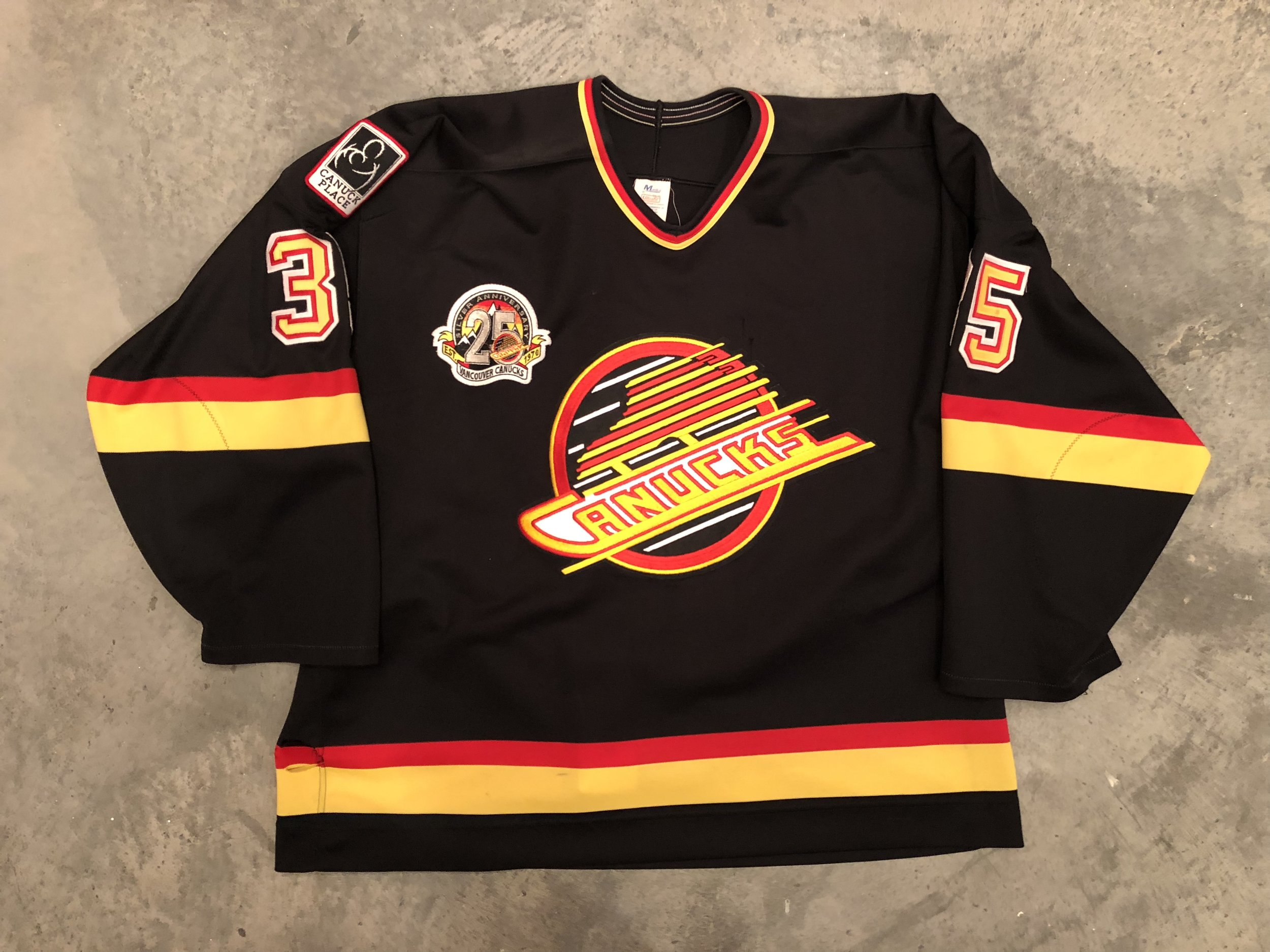1995 Kay Whitmore game worn road jersey with Canucks 25th anniversary patch