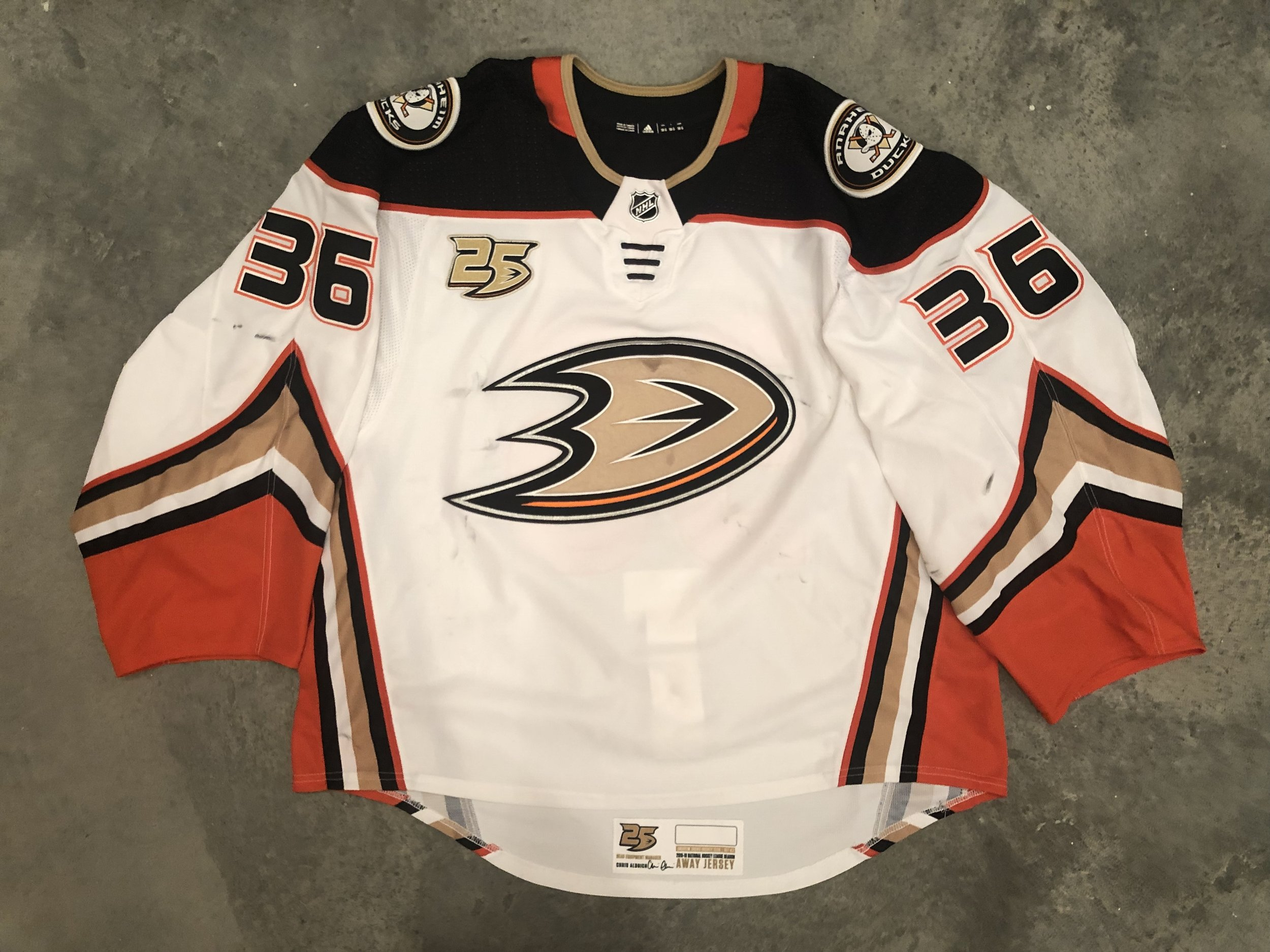 2018-19 John Gibson game worn road jersey with the 25th anniversary patch