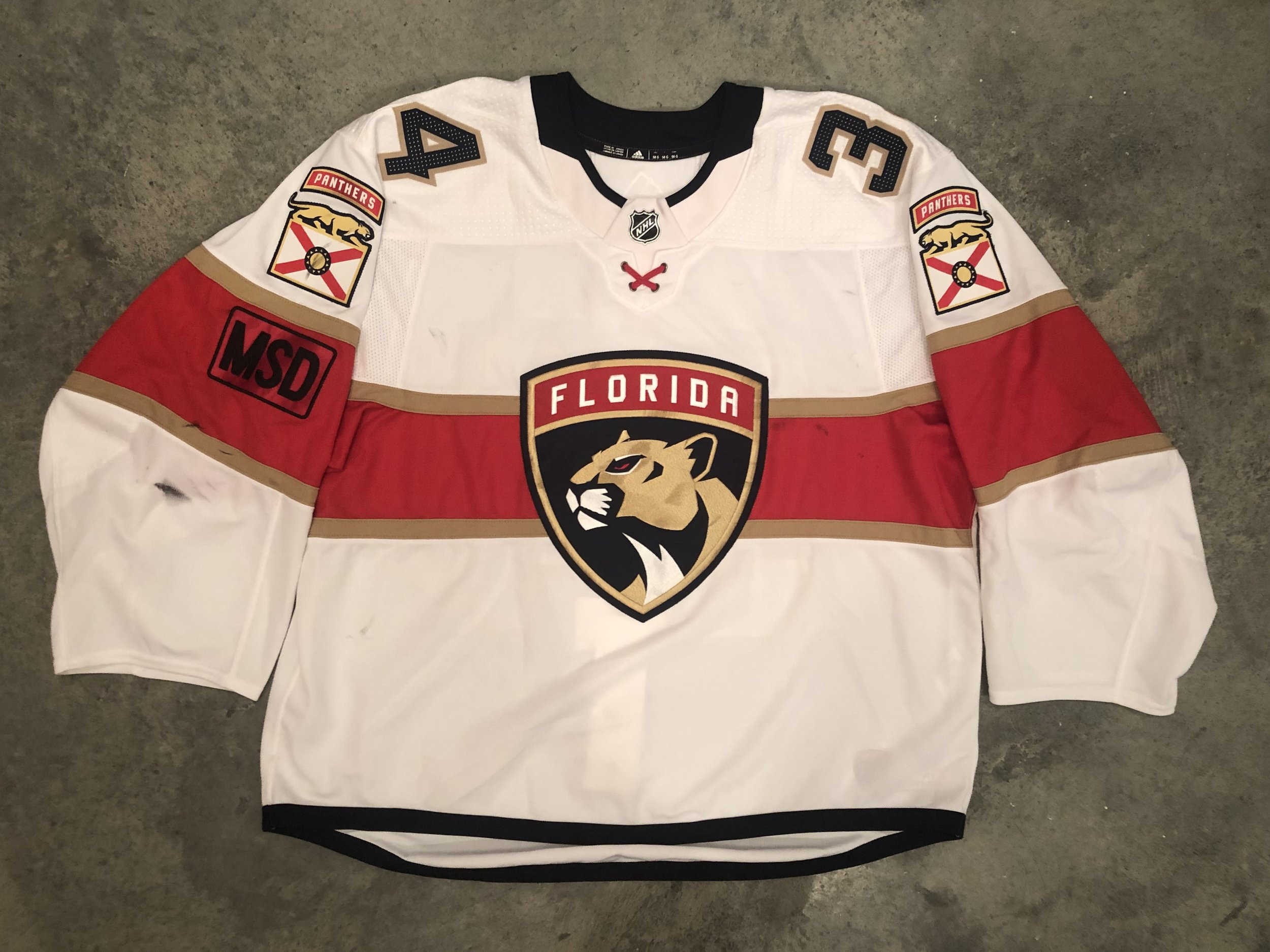 2017-18 James Reimer game worn road jersey with the MSD - Marjory Stoneman Douglas high school memorial patch