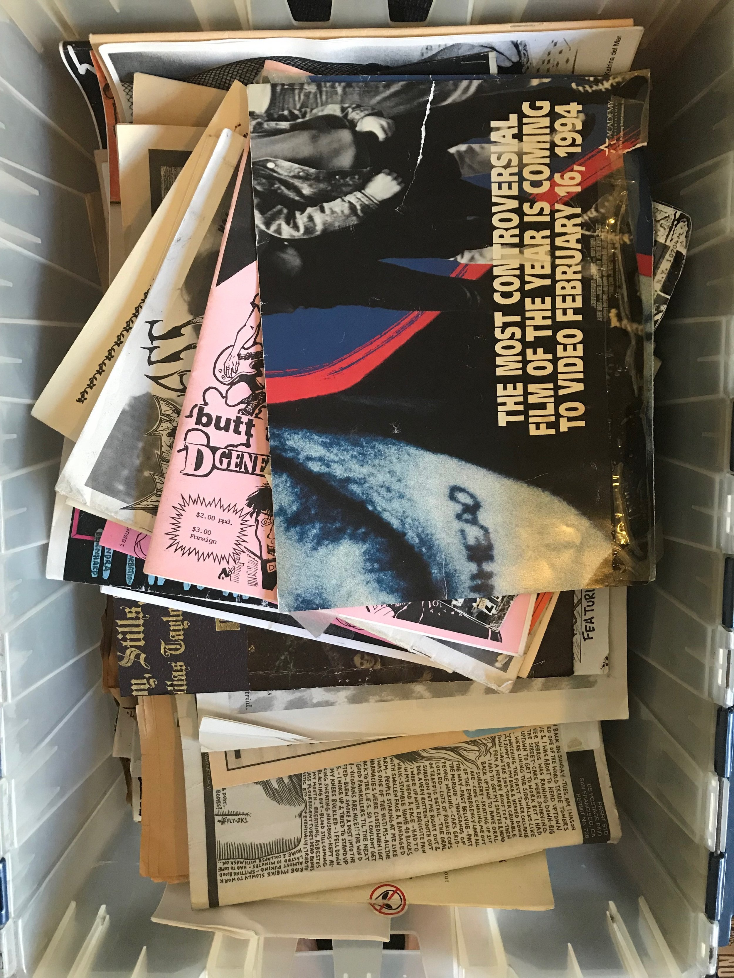 A bin of zines, including a  Romper Stomper  poster!