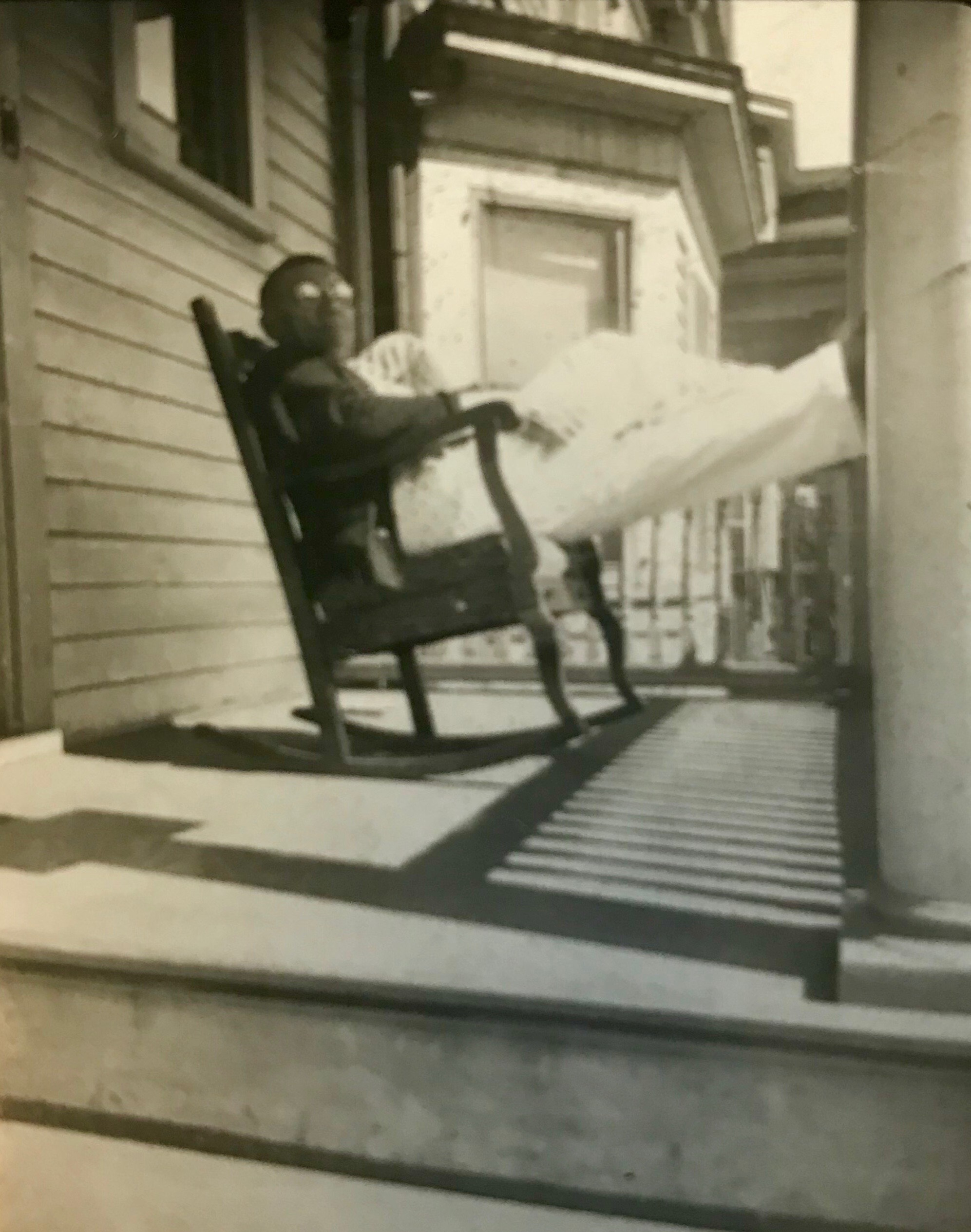 """Adolph Note from around this period. """"Scranton, PA"""" is written on the back but crossed off. This porch looks similar to the porch that my grandparents had in Scranton, so I'm confused. This image may also be from Paterson, NJ."""