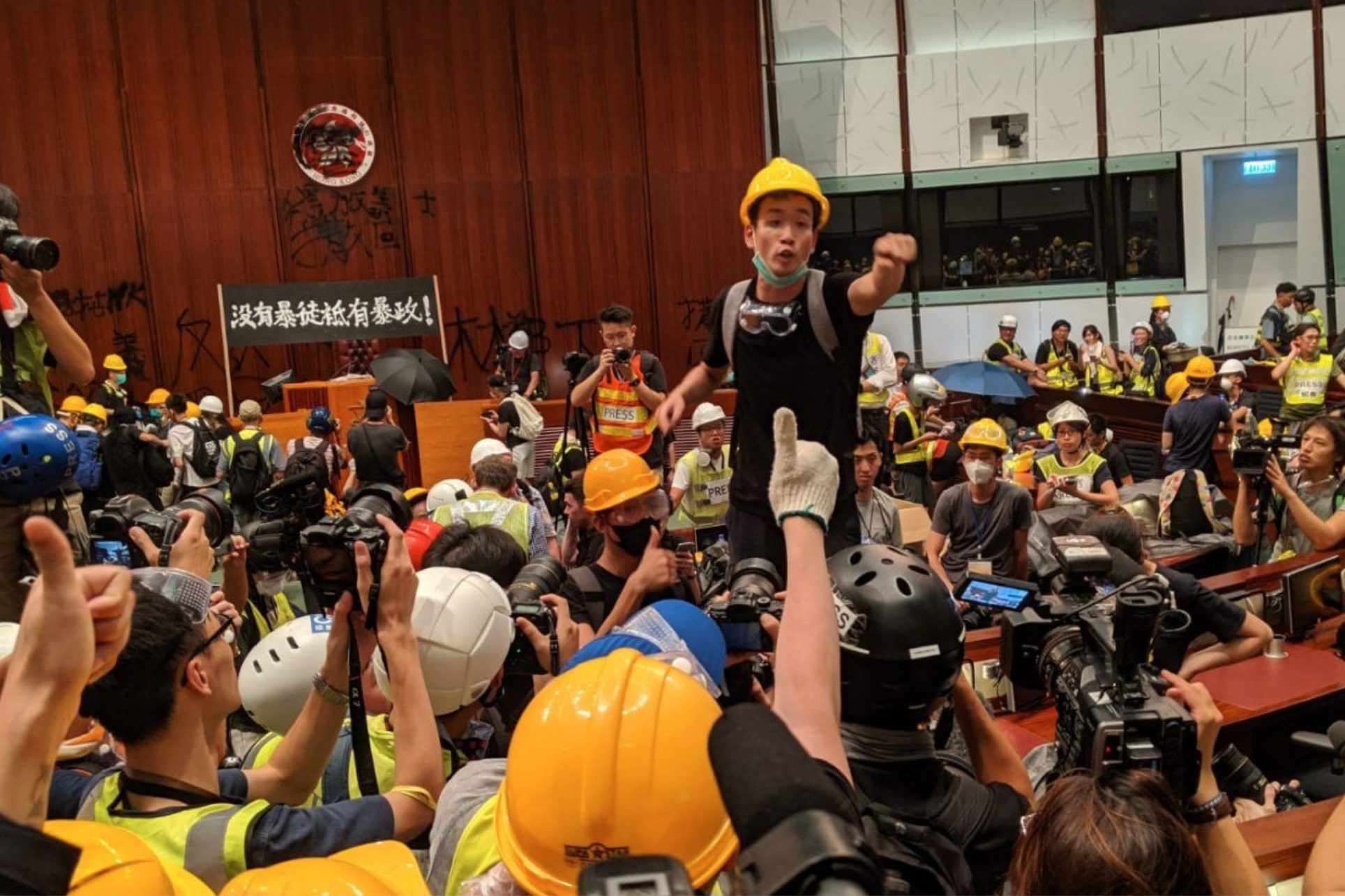 Unmasked Hong Kong protester says from US: we want 'full democracy' - Photo: Sum Lok-kei