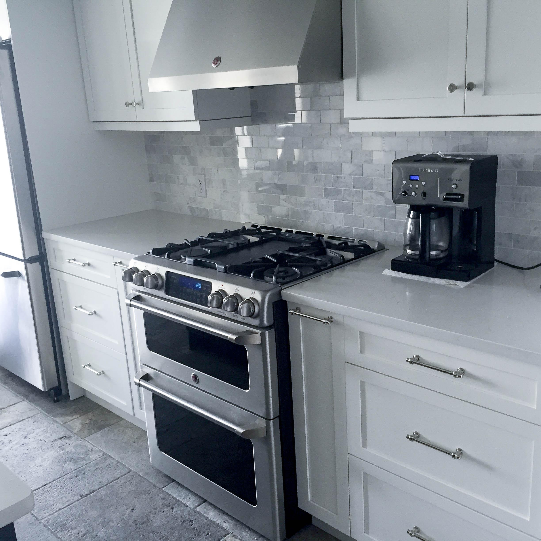 White Kitchen! White Cabinets,White Backsplash, White Counter