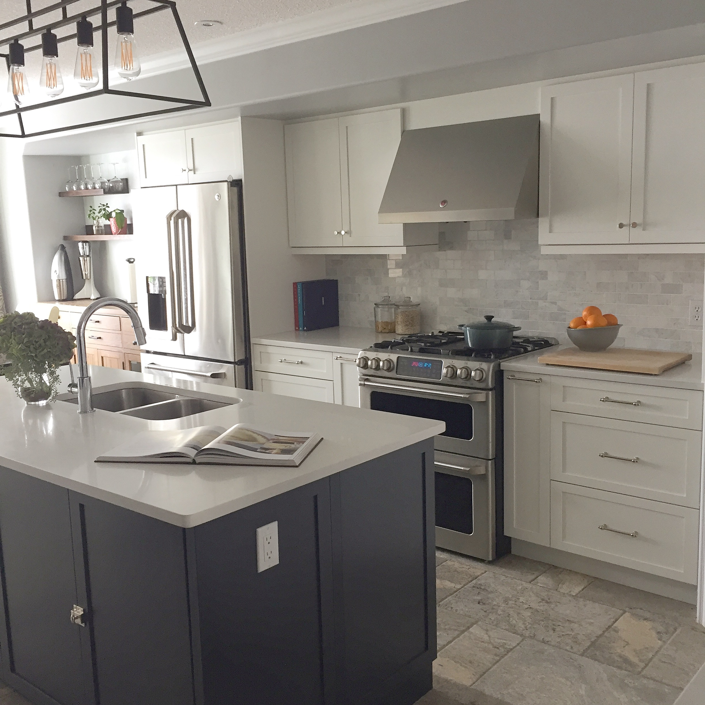 Aren't white Kitchens are the best? This two toned kitchen gets the best of both worlds.