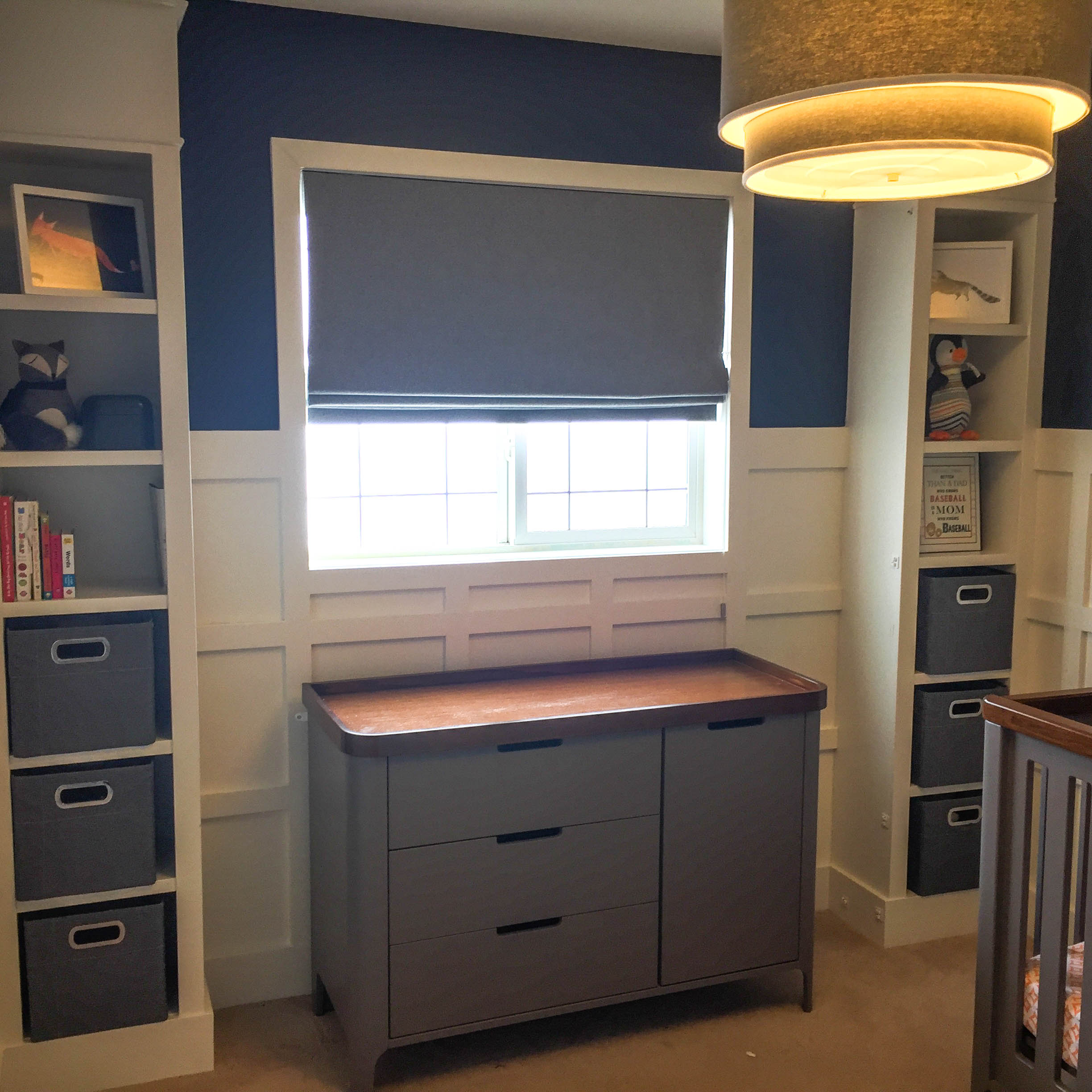 Our son's nursery, we did board and batten on the walls, and ikea built ins to add character.