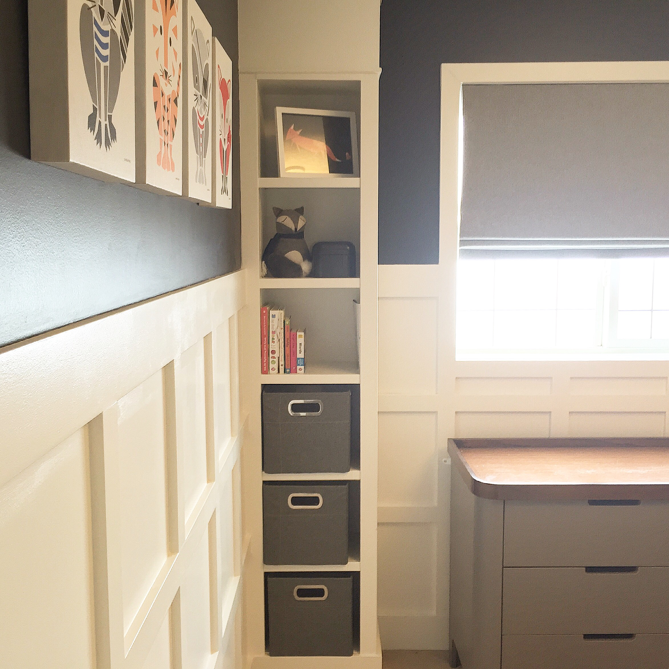 Boy nursery, with board and batten walls, lots of natural light. Wall colour is BM Hale Navy.
