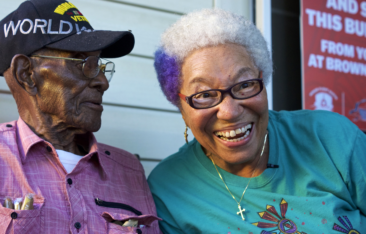 Austin City Council Member Ora Houston helps Richard Overton celebrate his 112th birthday on May 11, 2018.