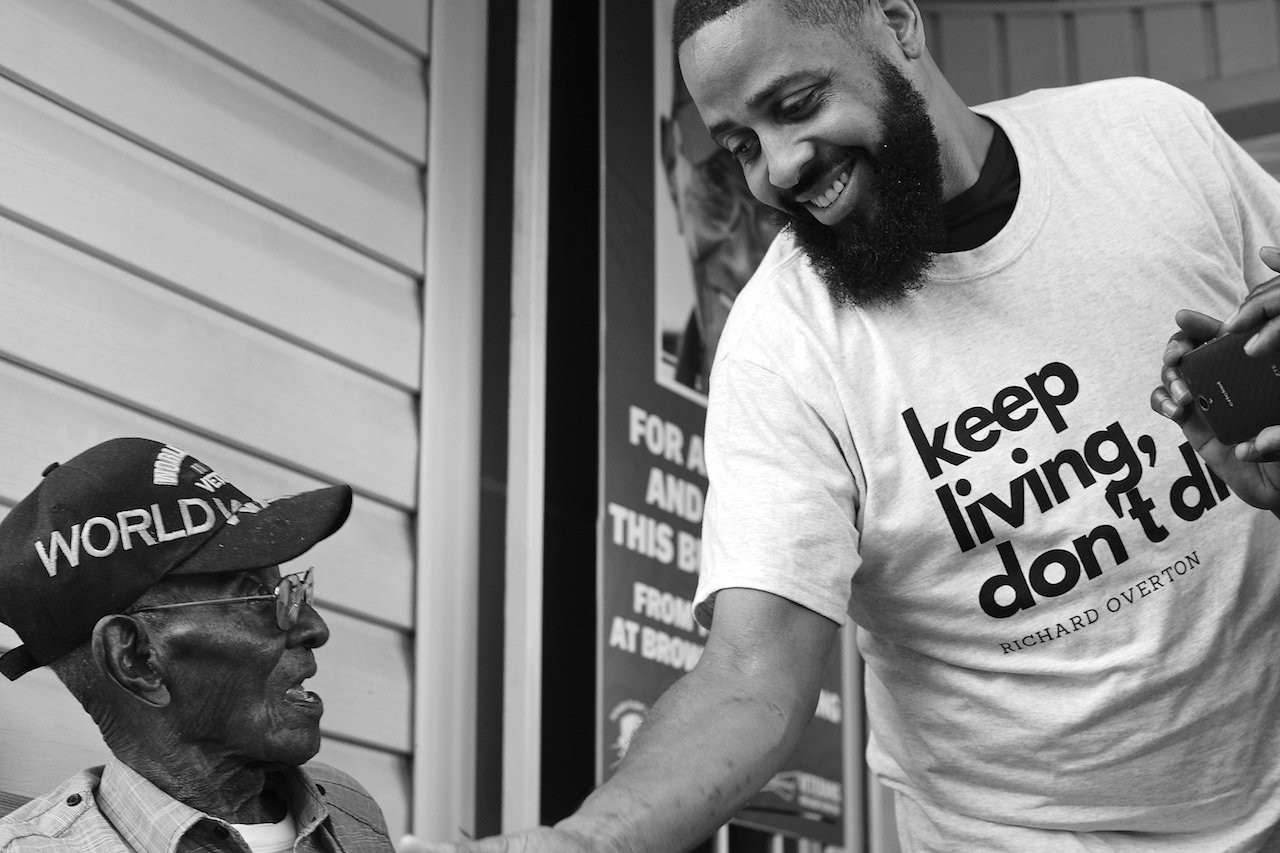 "Some people at Richard Overton's 112th birthday party on May 11, 2018, wore T-shirts bearing his mantra: ""Keep living, don't die."""