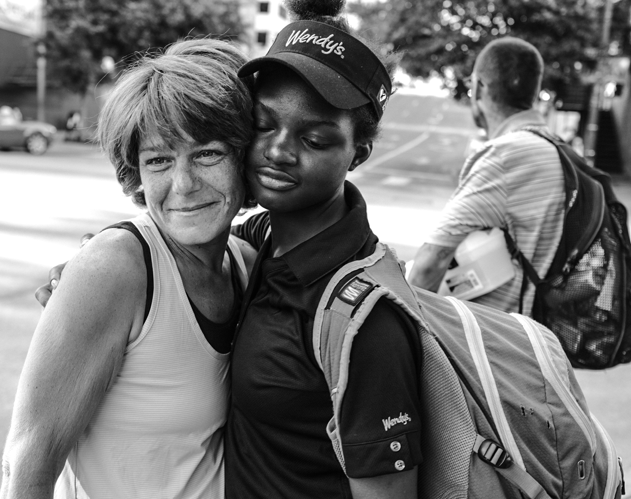 Elizabeth, left, lends her emotional support to 20-year-old Zakila Marina on Sixth Street in downtown Austin.