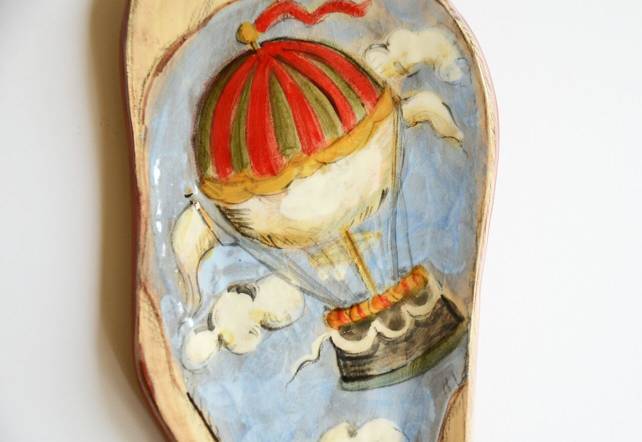 "Up, Up and Away, Earthenware Spoon Rest, Underglazes and Glaze, 4 1/2""w x 9 1/2""h x 1/2""d"