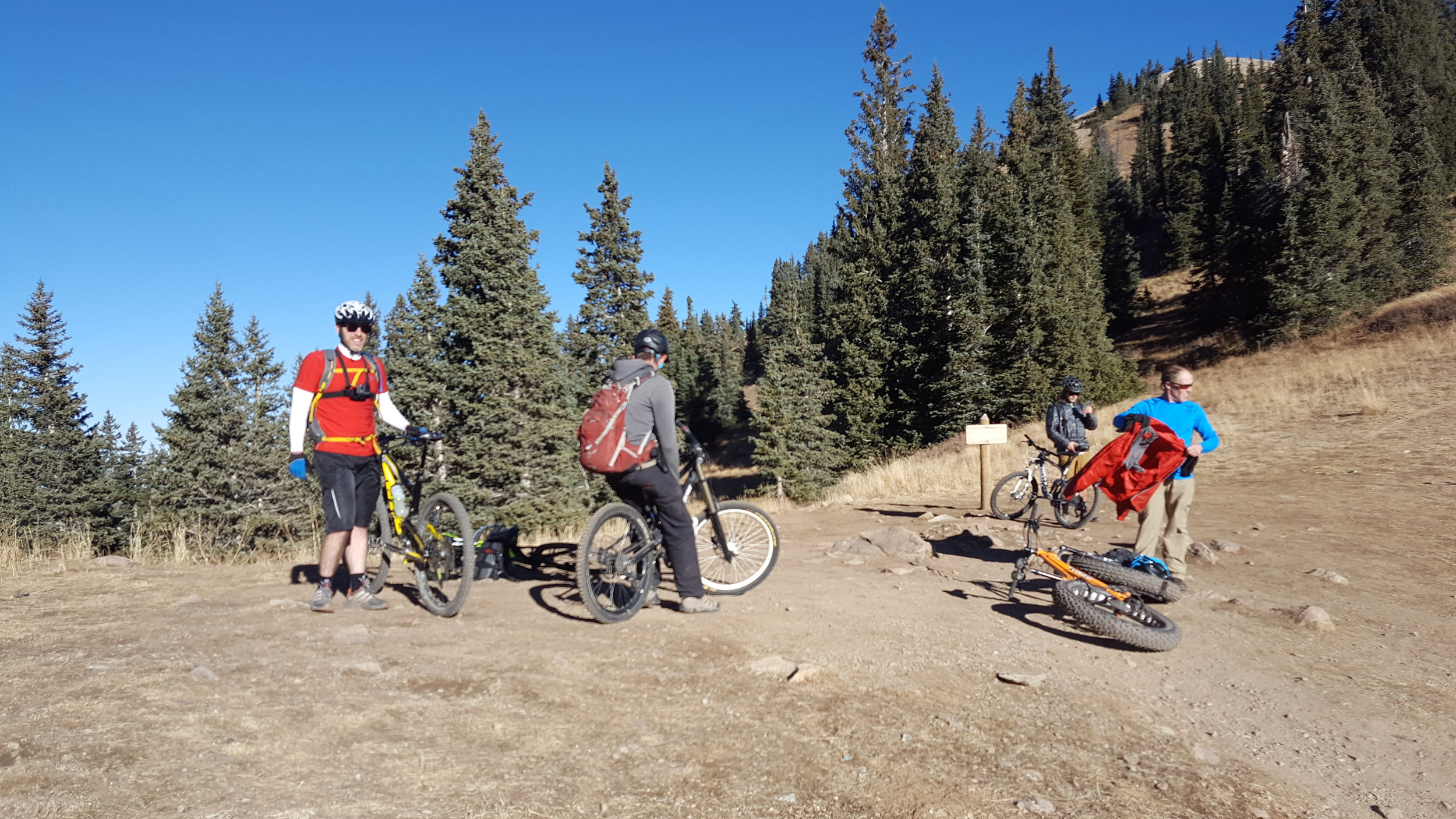 Group rides are always a lot of fun. Our group takes a break after climbing Burro Pass on the Whole Enchilada.