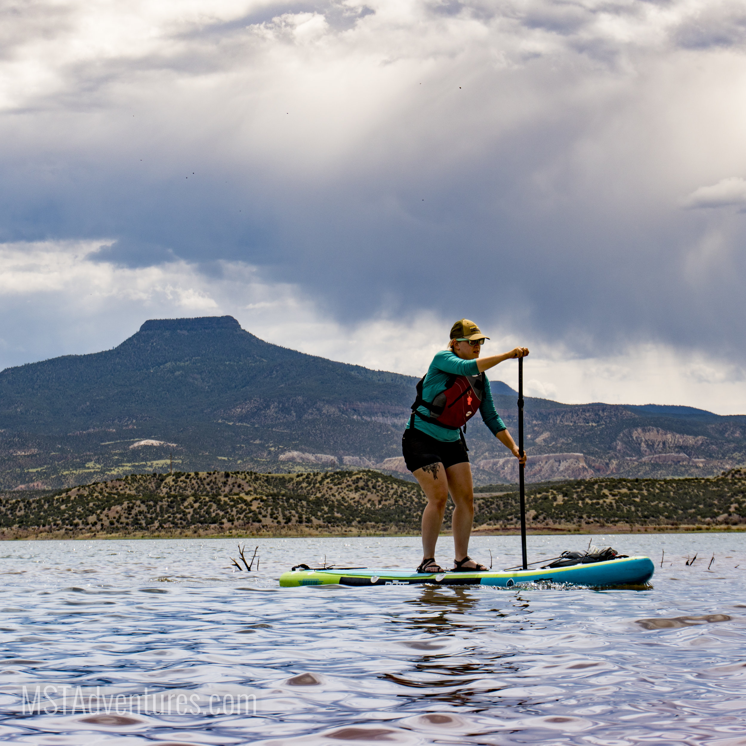 Rental SUP and PFD on Abiquiu Lake, Pedernal in background. Abiquiu, NM; Campsite and Sunset at Abiquiu Lake.