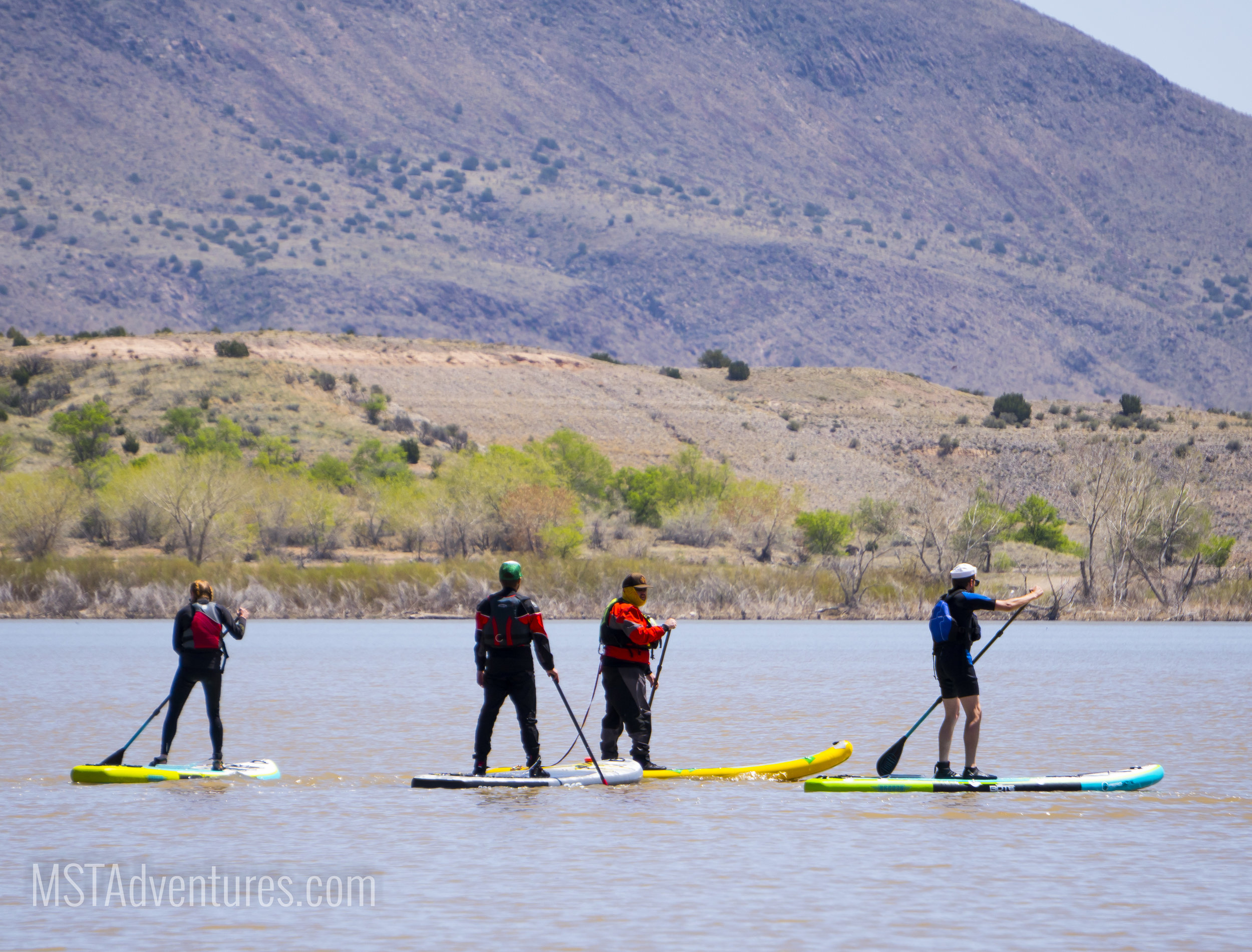 Enjoying an early-season paddle with friends on Cochiti Lake