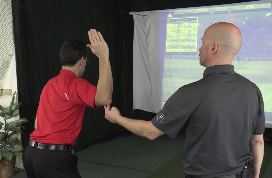 Dan demonstrating a swing mechanics drill.