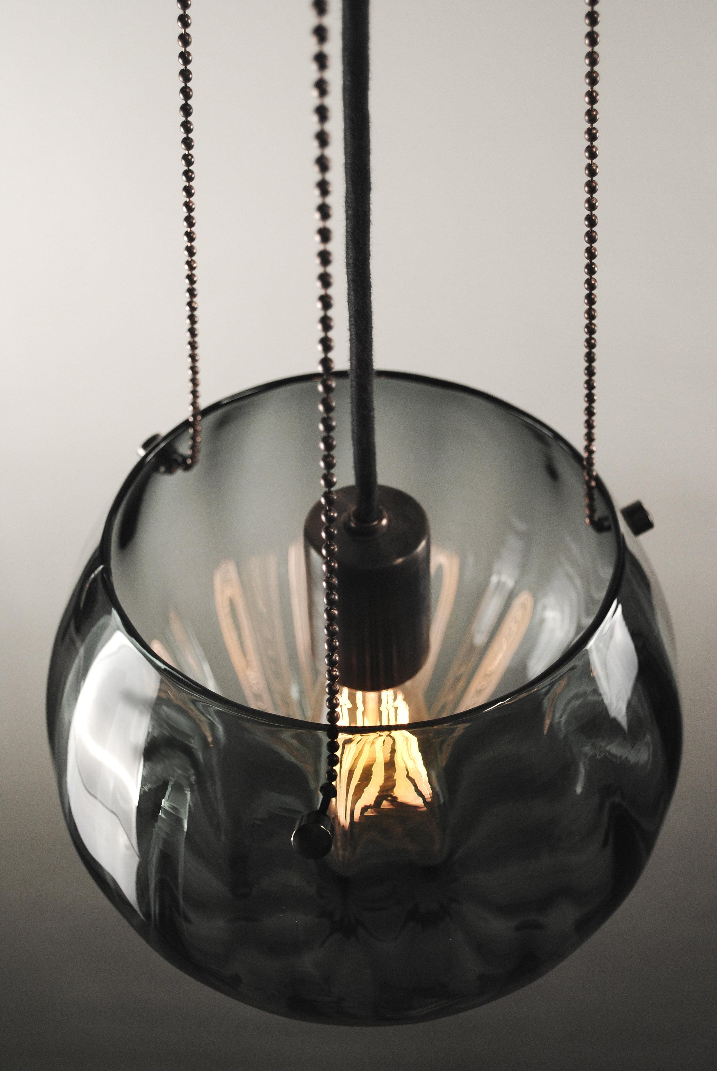 Shown in Dark Bronze and Gradient Grey Glass