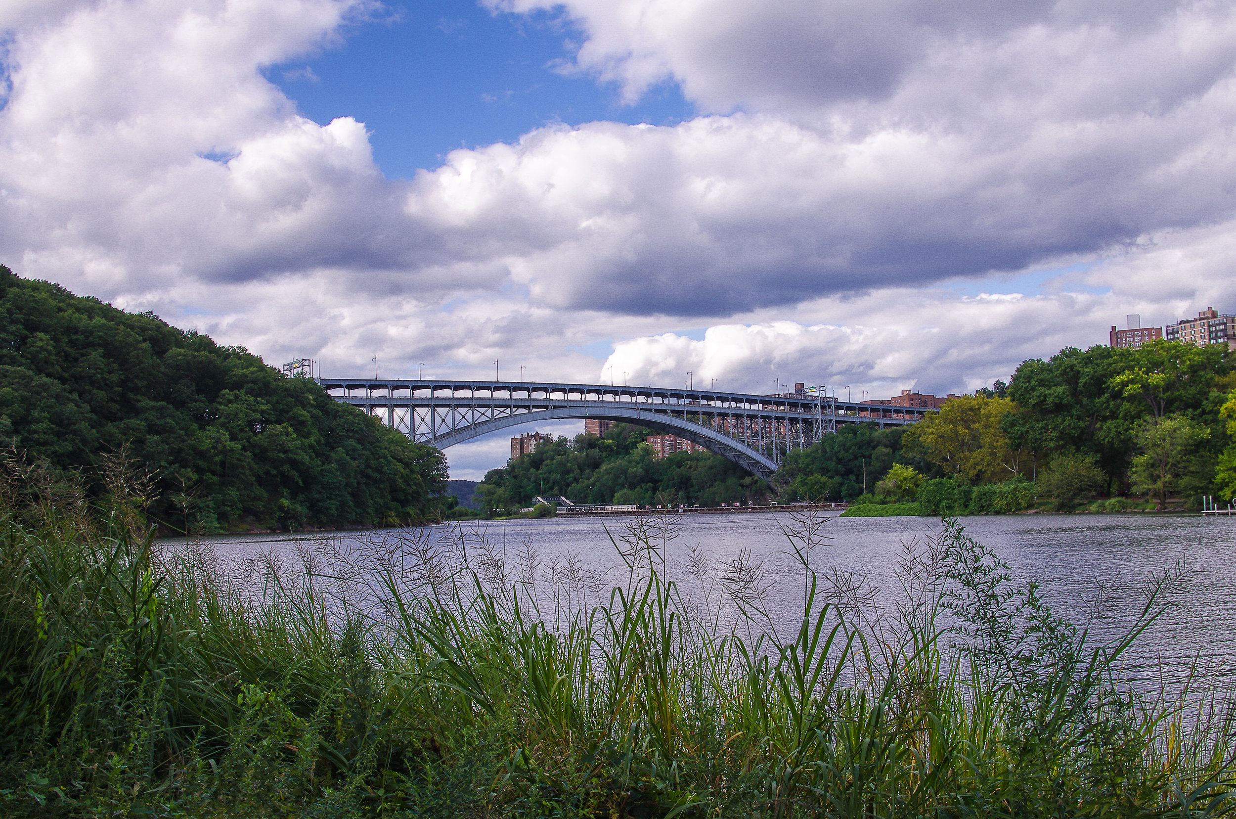 The Henry Hudson Bridge from the banks of Inwood Park and Spuyten Duyvel Creek