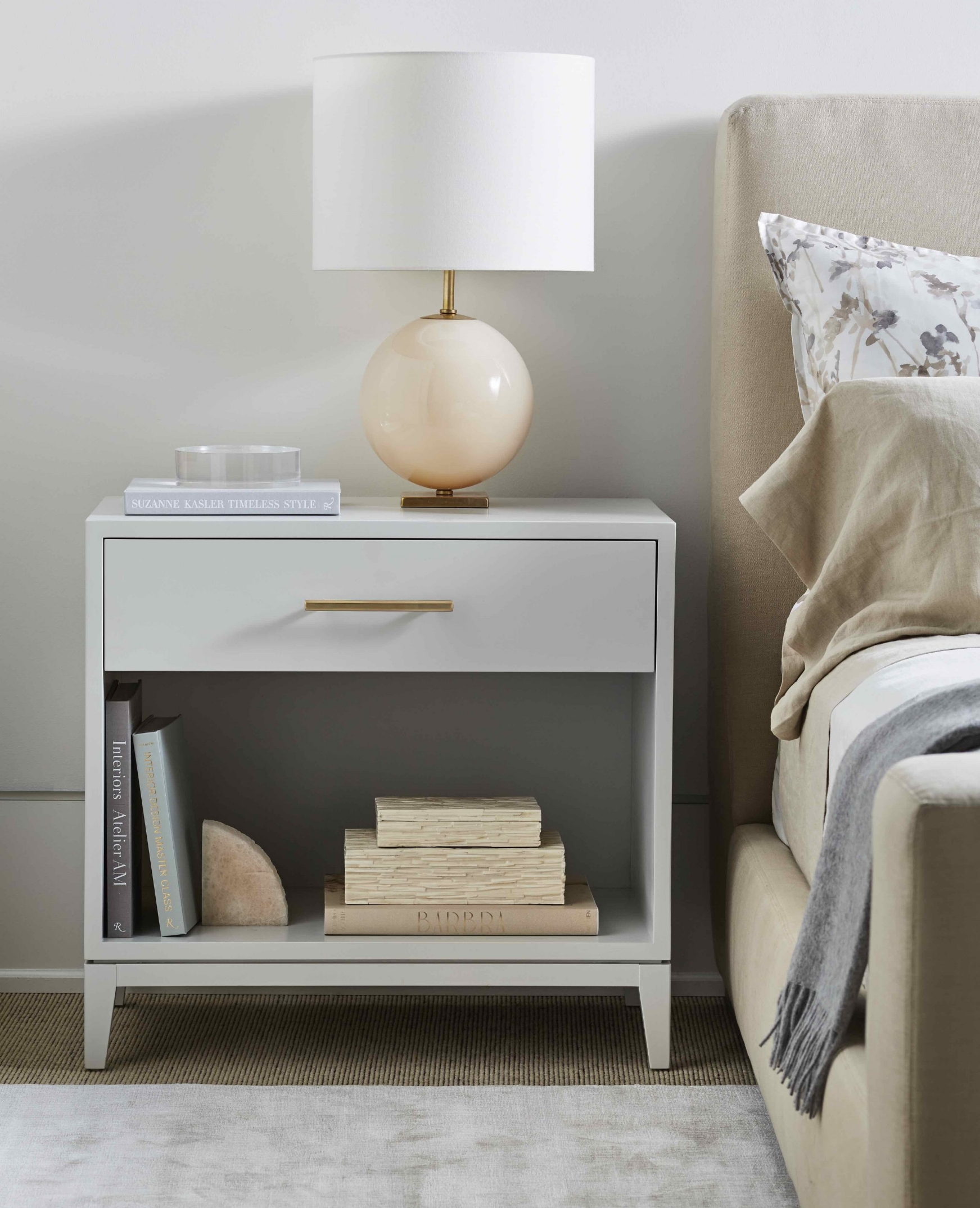 This solid wood nightstand with full-extention drawer, painted finish in Grey Owl by Benjamin Moore and brass octagonal bar pull, $1,800.