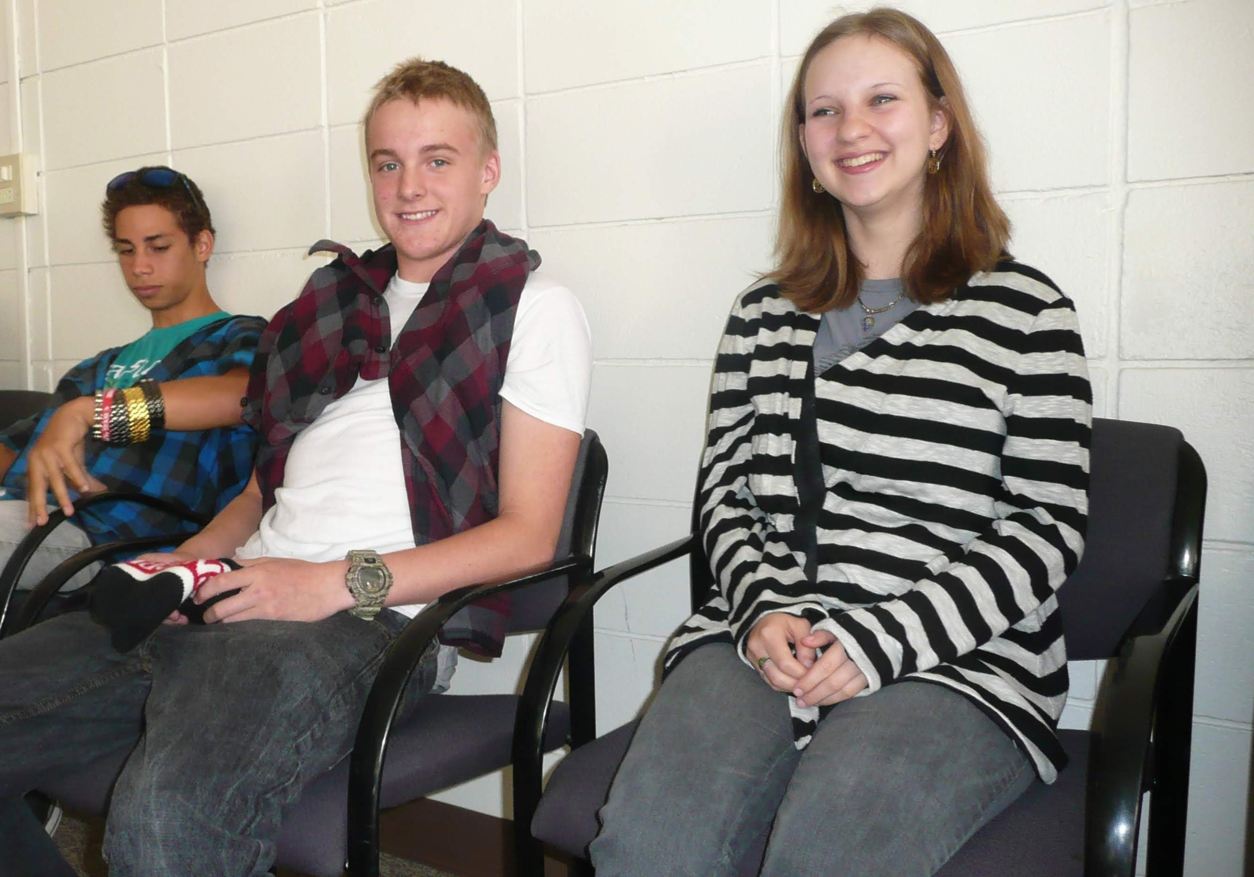 High school students smiling in class