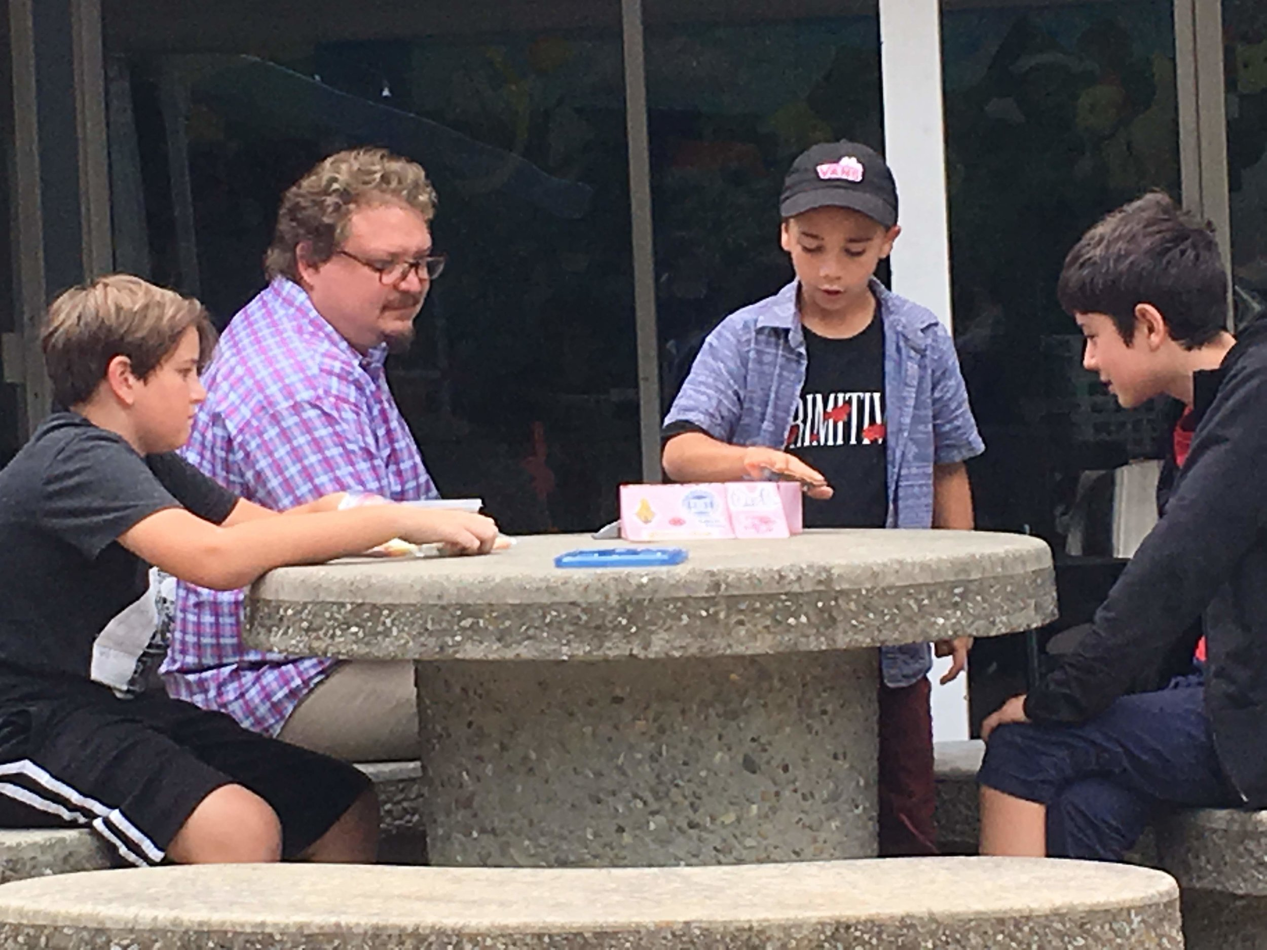 Faculty member sitting with middle school students