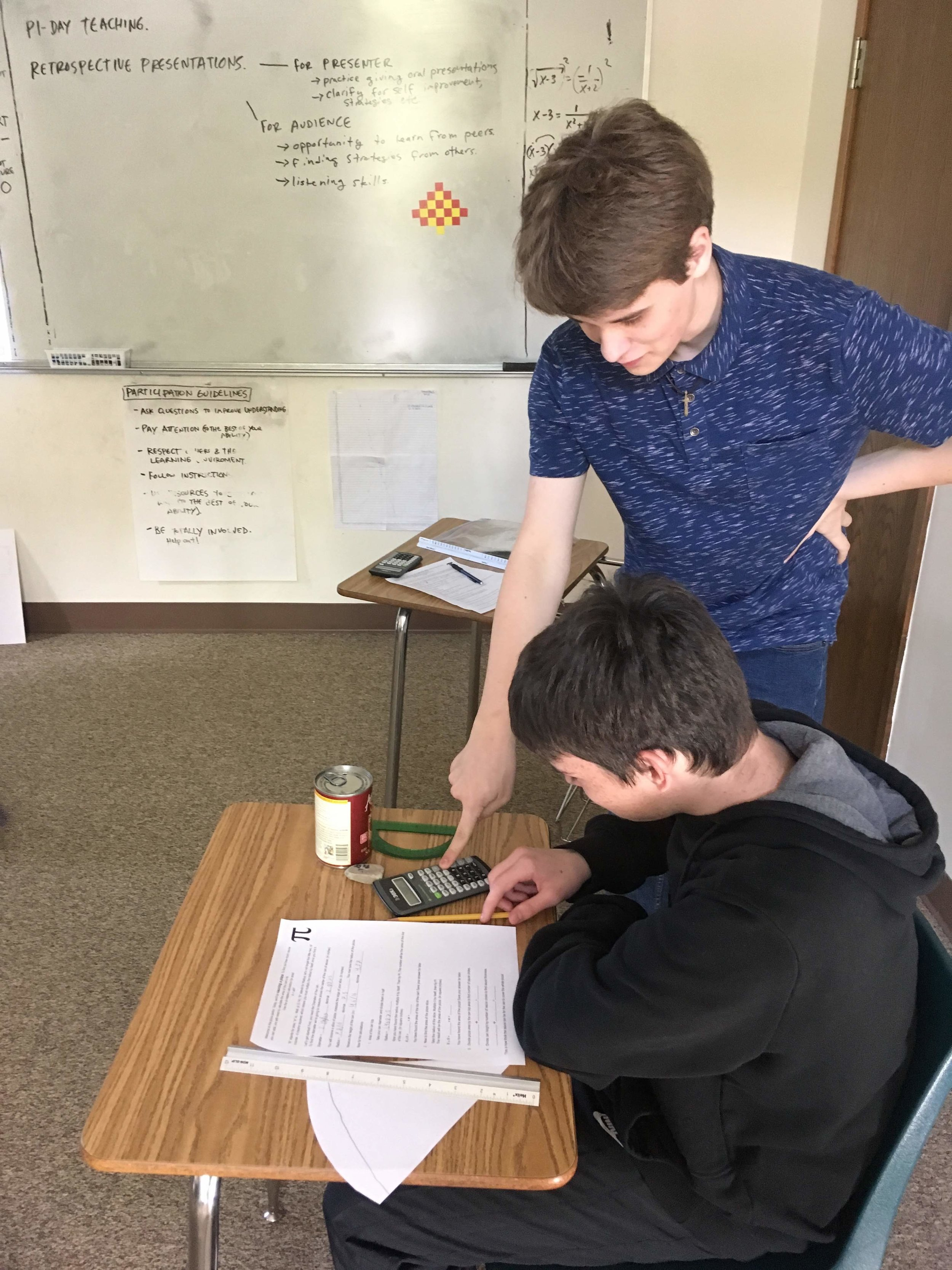 One student providing educational support to another
