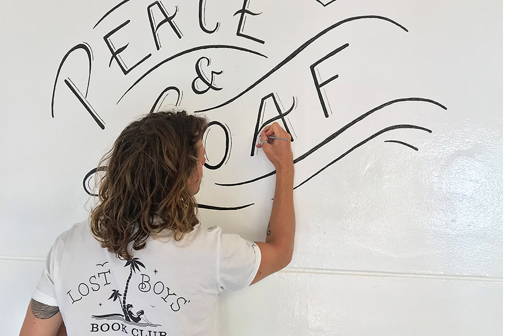 Pete Adams working on the 'Peace & Loaf' Lettering Mural for STAPLE Bakery, 2018.