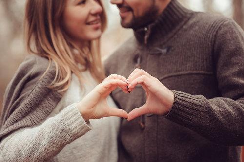bigstock-young-happy-loving-couple-show-109395056.jpg