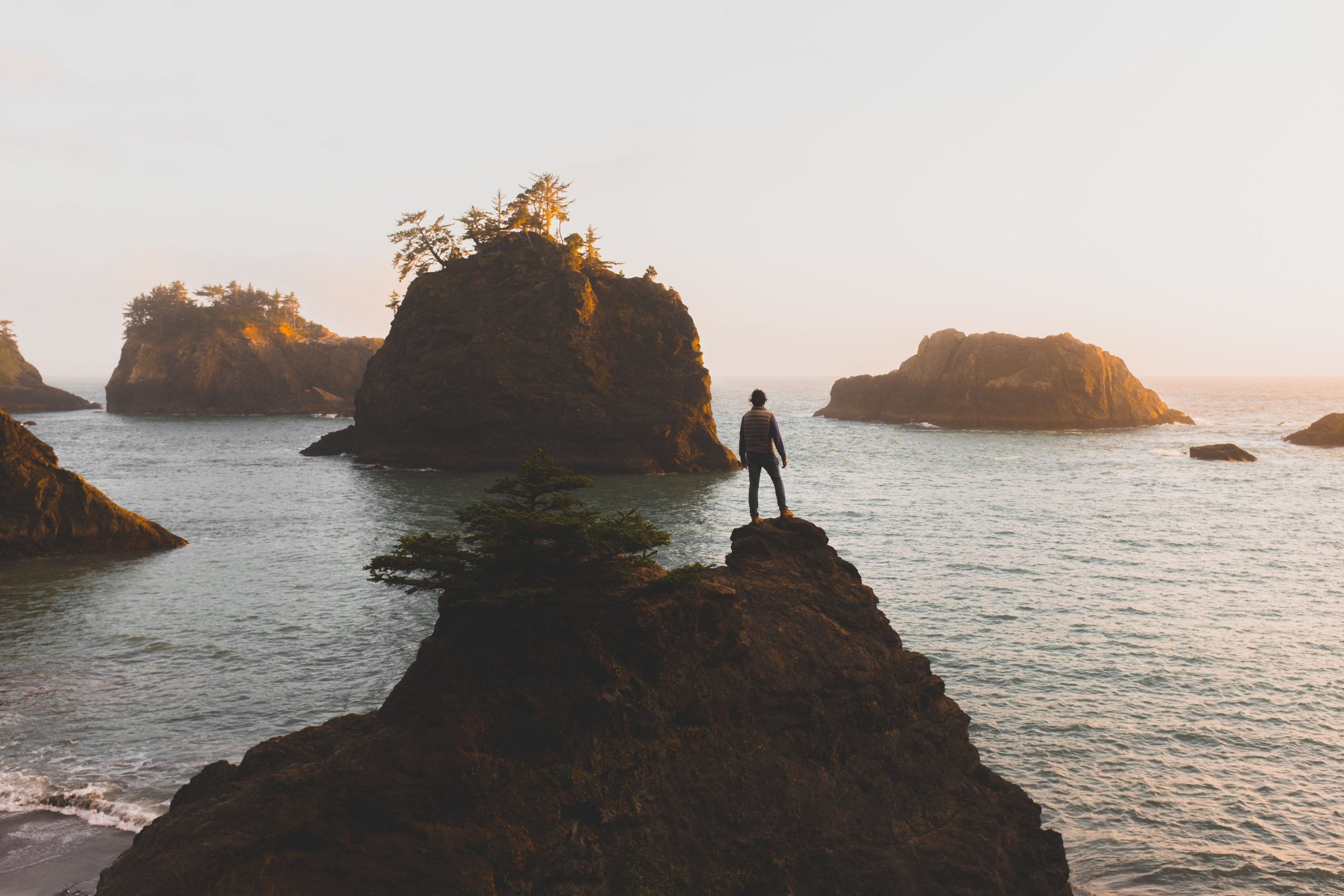 ***man on rock crags in ocean - $ SAVING TIPS StockSnap_8YBFQQ6C5A.jpg