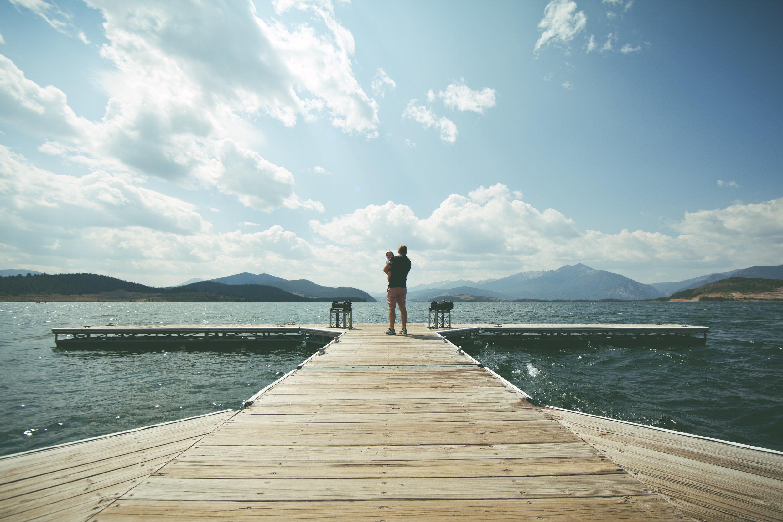 **dad baby dock water mountain landscape - INHERIT-BENEFICIARY StockSnap_HRPBX2ENGR.jpg