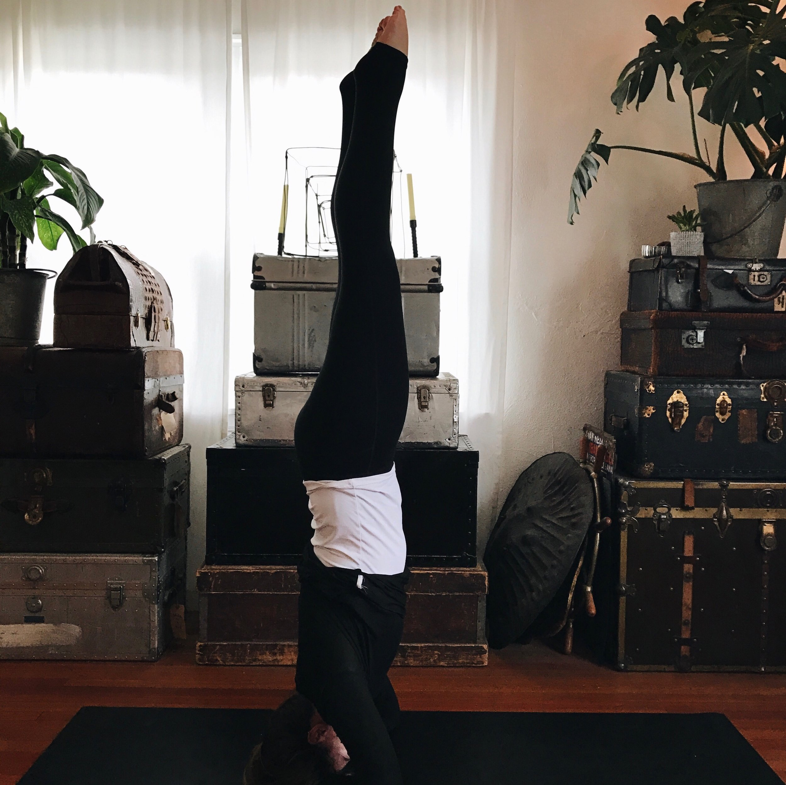SUPPORTED HEAD STAND: This uses almost complete core strength. Clasp hands around head for support and slowly walk feet towards face before lifting the feet off the ground.