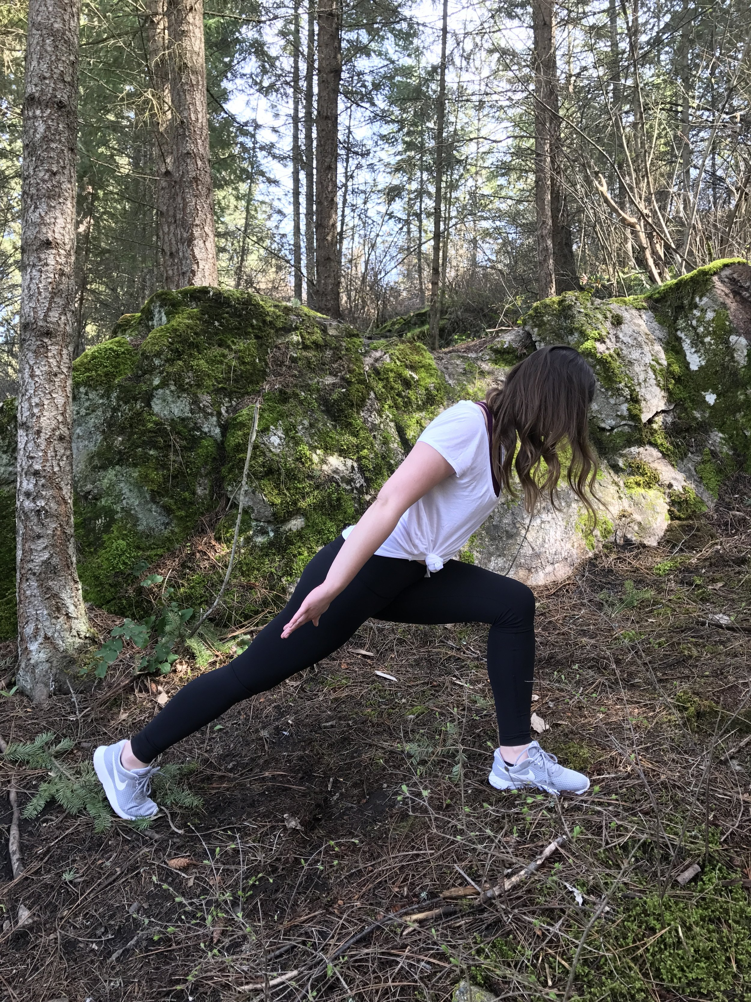 Slowly lift the upper body up, pressing the front foot firmly into the ground. Arm are back, palms facing up.