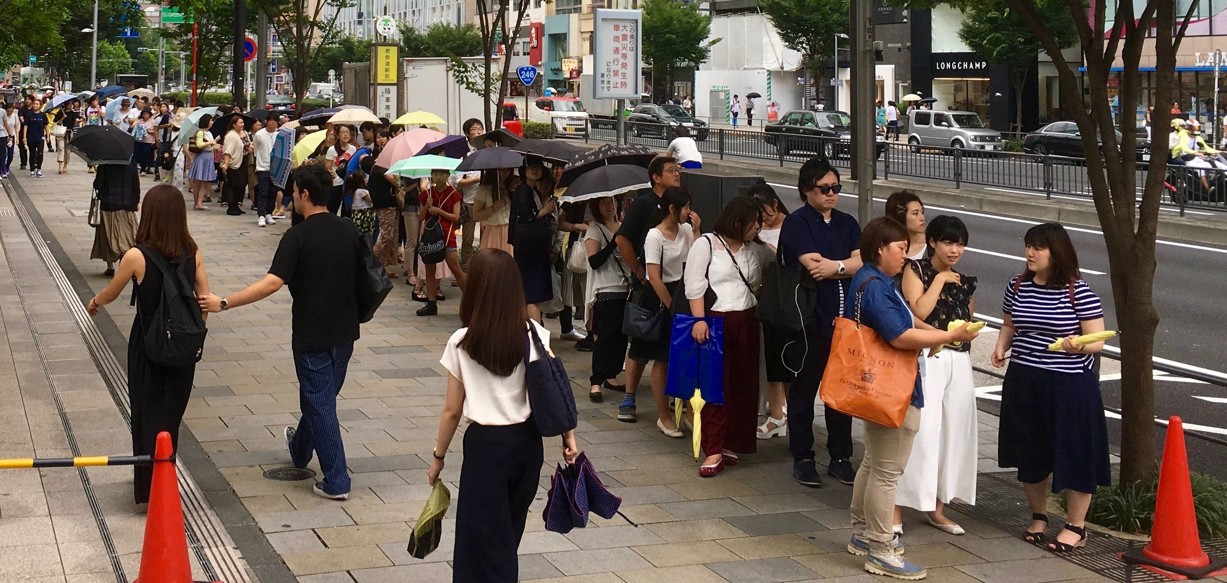 A long queue outside the Lipton Fruits in Tea shopfront in Omotesando, Tokyo (31 July).