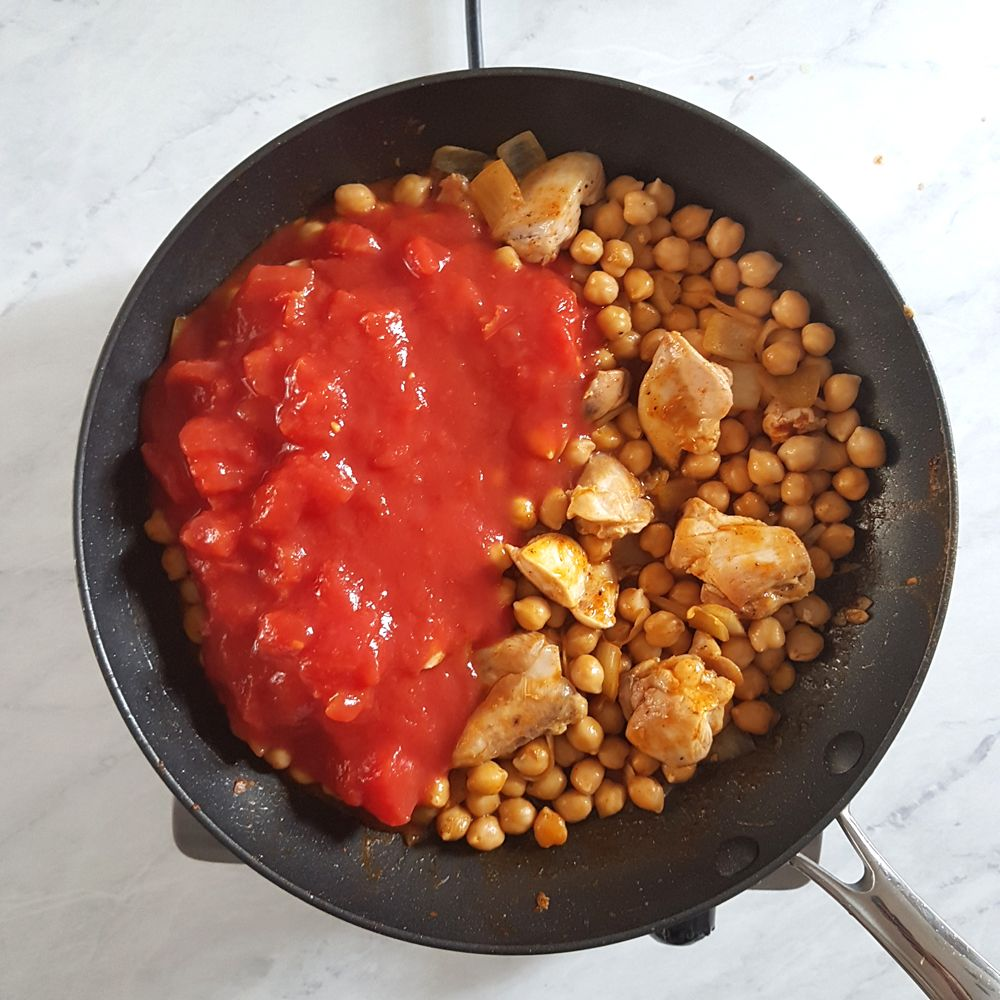 Add the chopped tomatoes. Cook until the liquid has reduced and the chicken has cooked through, approx. 8-10 minutes.