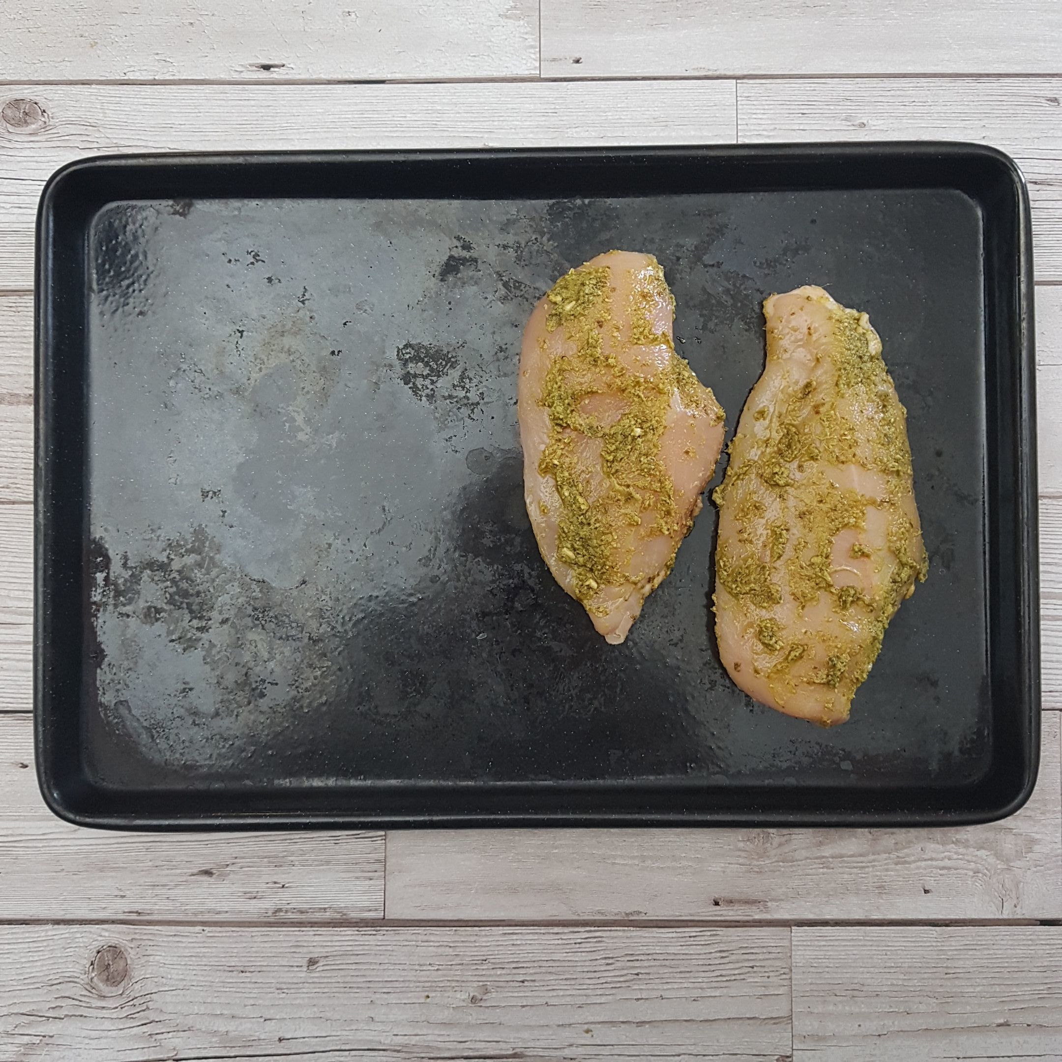 Place the chicken on an oven tray and bake for 10 minutes. Set a timer!