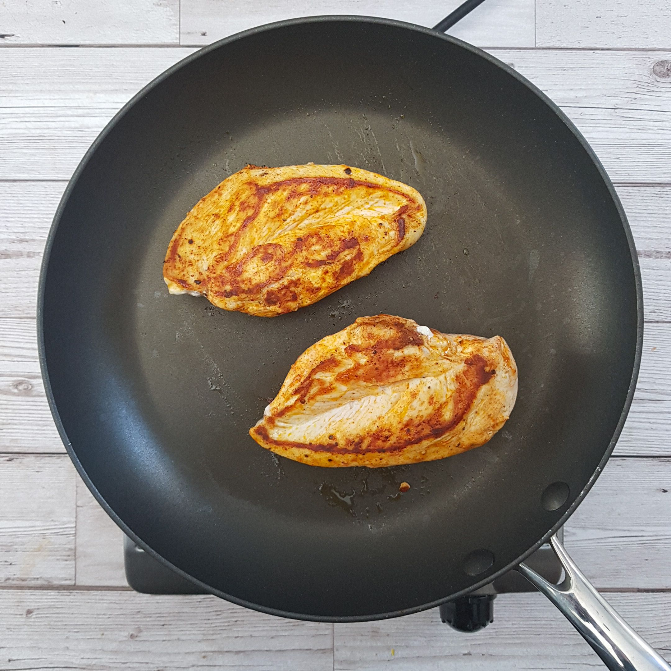 Meanwhile, Get a non-stick frying pan hot and add the chicken breasts. Lower the heat to medium and cook each side for 6-8 minutes. Until the juices run clear and the meat is white all the way through