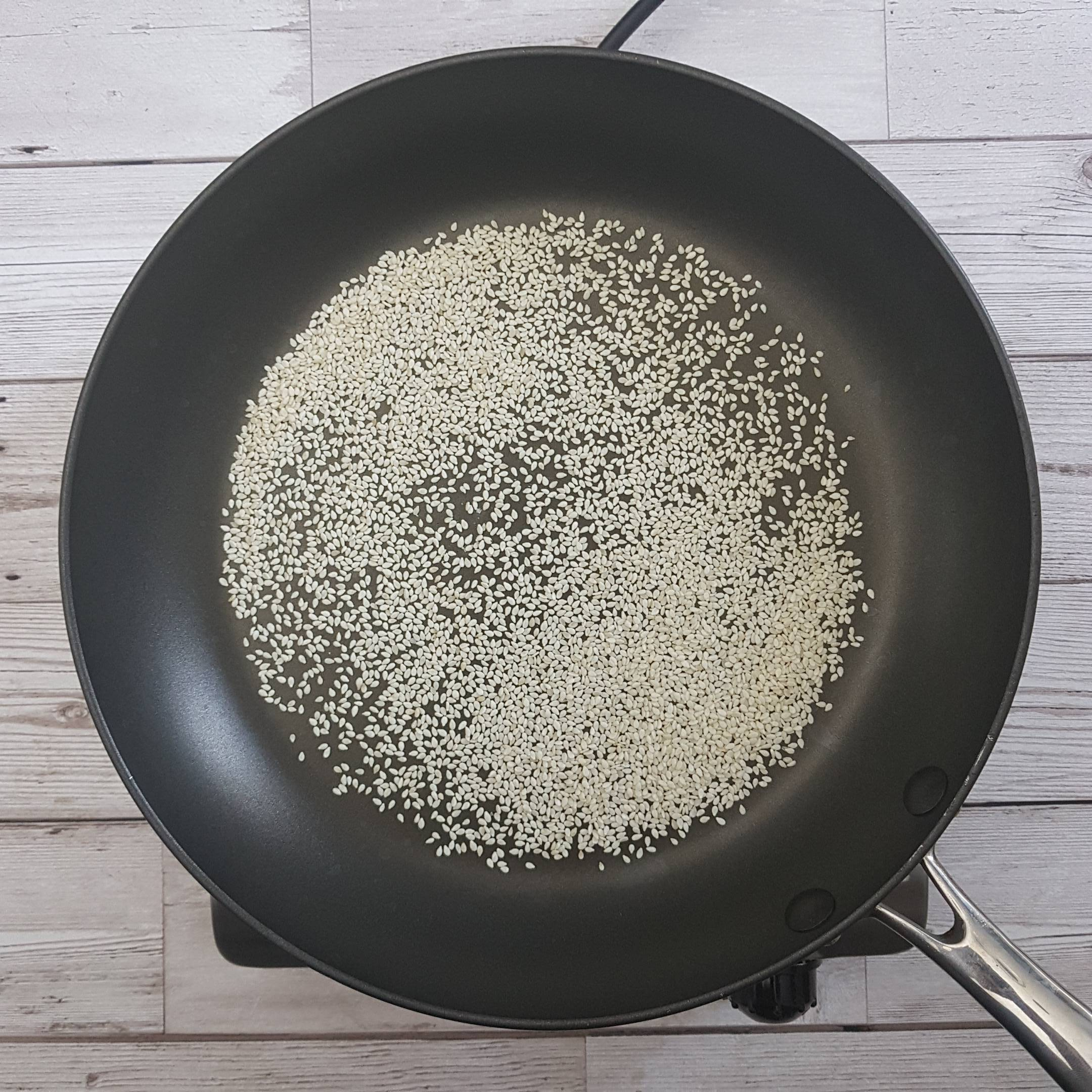 Add 2 tbsp sesame seeds to a non-stick frying pan and cook for 1-2 minutes until golden brown. Move them around so they do not burn.