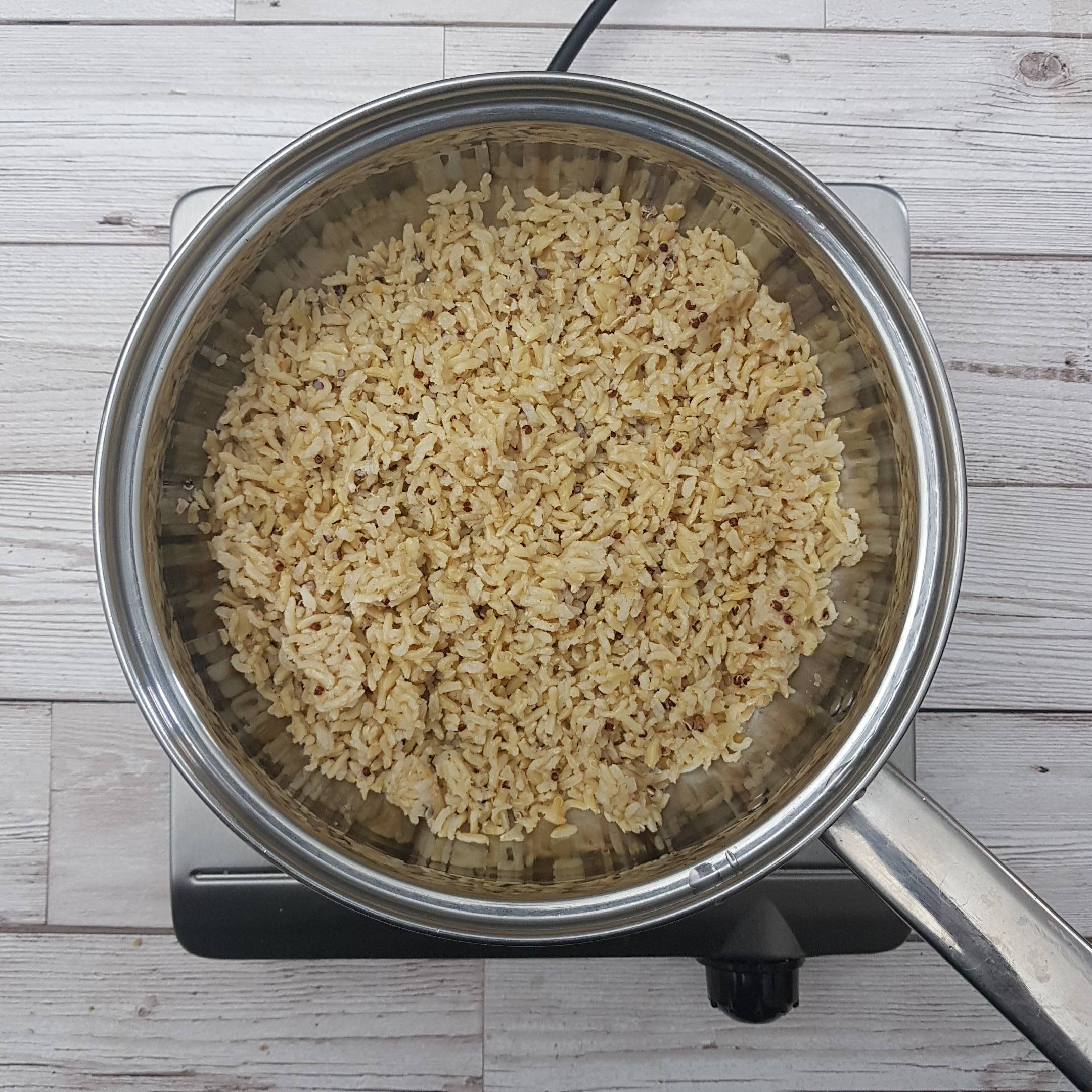Add a splash of water to a pan and heat the rice for 2 minutes until hot.  (or follow the packet instructions for microwave).