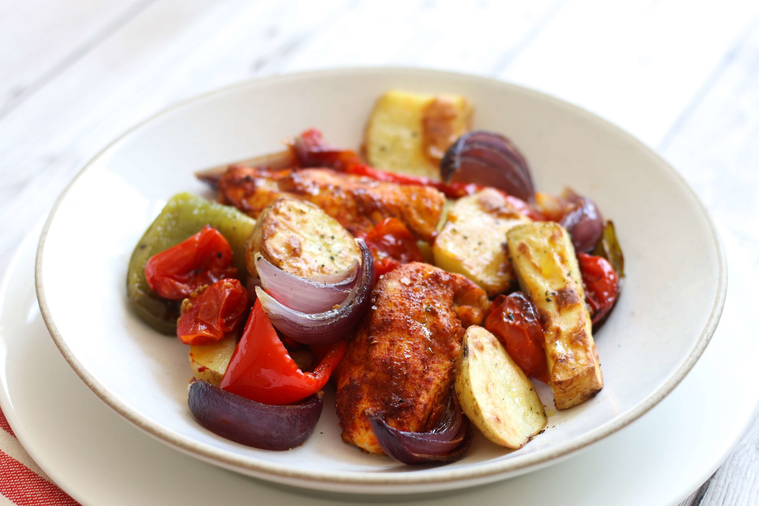Tender chicken breast in tandoori spice with roasted vegetables