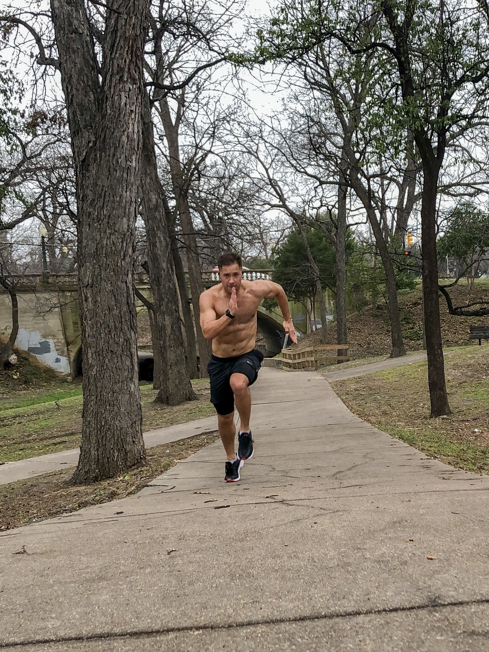 It's hard to flex and run at the same time. Katy Trail, Texas