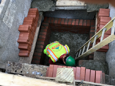 Contractor placed brick for brick manhole. 28+08RT