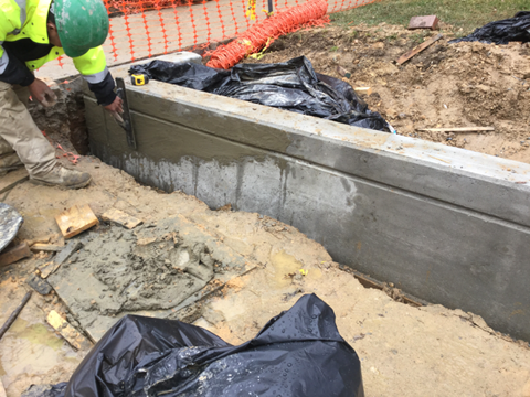 Finishing surfaces of coping wall. Station 37+05RT to 39+00RT