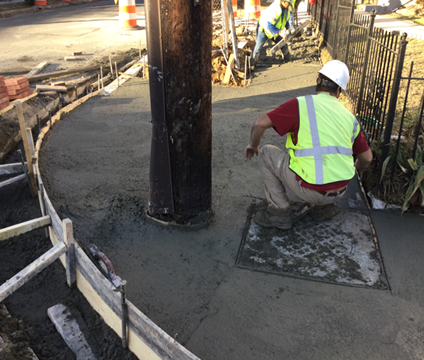 Finishing PCC ramps at stations 23+70LT and 181+82RT. Adjusted manhole also shown at station 23+70LT.