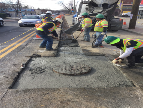 PCC Base Pour Around M-26 and Utility Cut