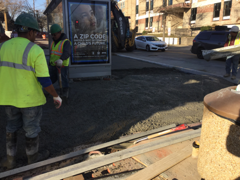 Contractor placing and finishing PCC base for brick sidewalk, stations 152+00LT to 152+40LT